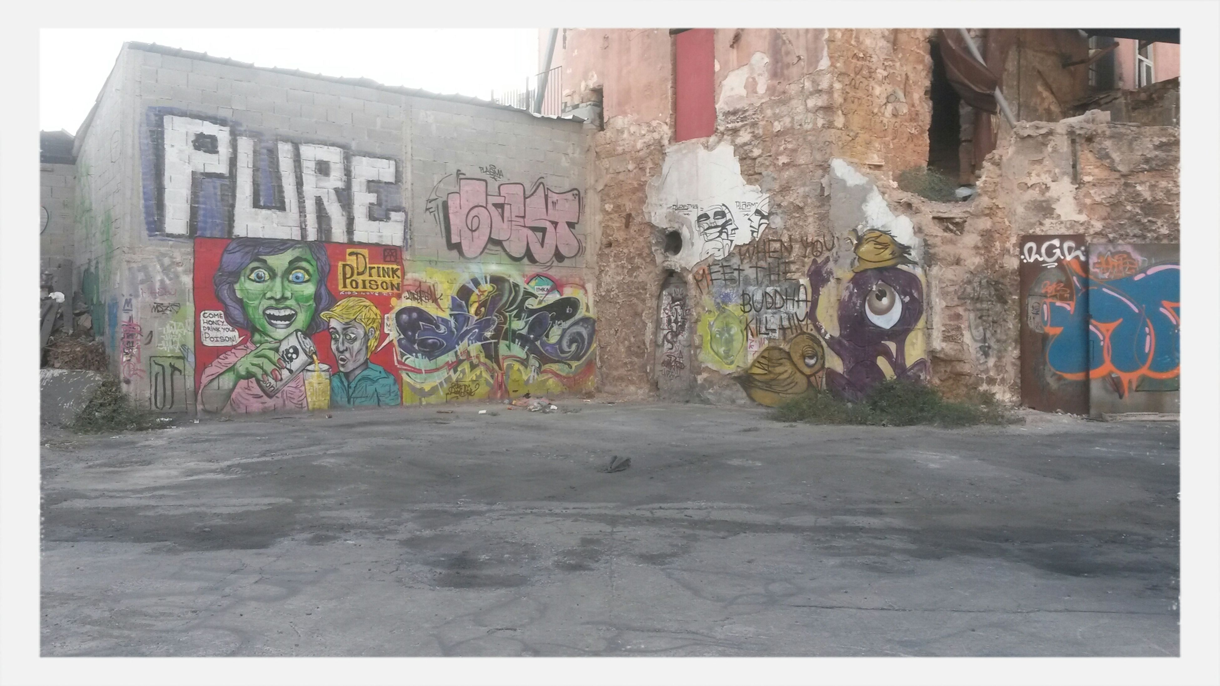 graffiti, wall - building feature, built structure, art, architecture, creativity, text, art and craft, transfer print, building exterior, western script, wall, street art, communication, auto post production filter, vandalism, multi colored, day, street, no people