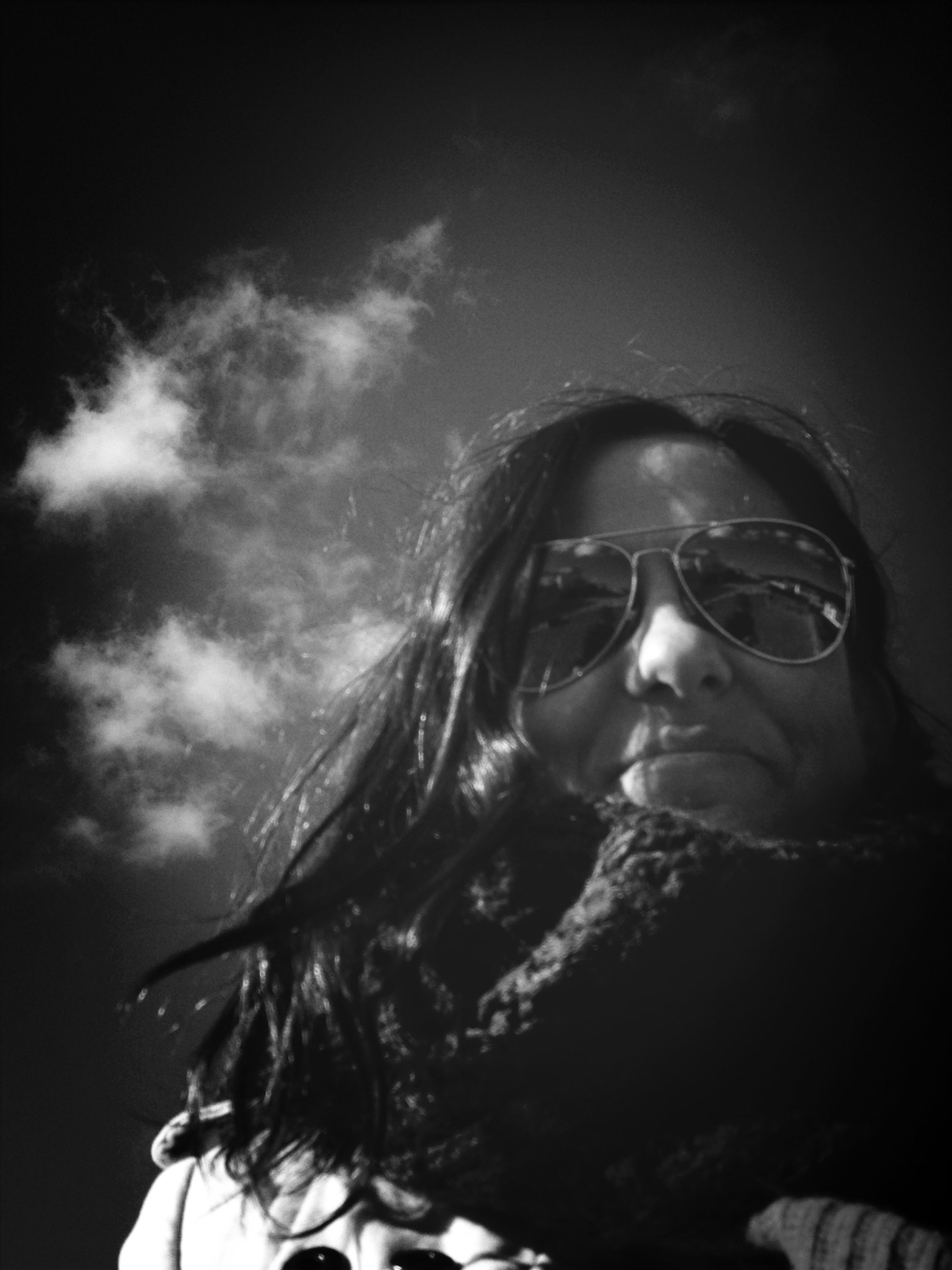 young adult, portrait, looking at camera, headshot, person, lifestyles, young women, front view, leisure activity, head and shoulders, sky, smiling, close-up, sunglasses, long hair, mid adult