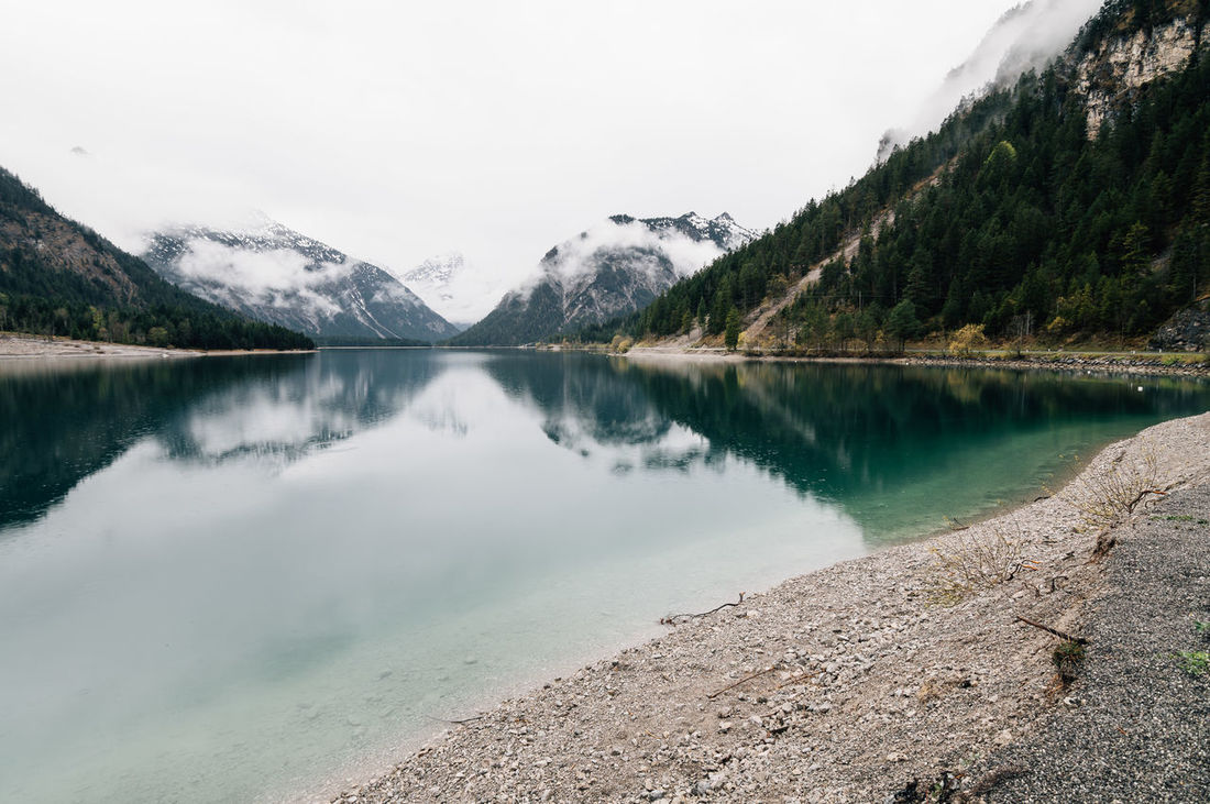 Plansee lake with mountains reflections on water a misty day Adventure Al Beauty In Nature Clean Day Lake Lake View Lakeside Landscape Mist Misty Morning Mountain Mountains Nature Nature No People Outdoors Plansee Reflection Scenics Sky Tree Turquoise Walking Around Water