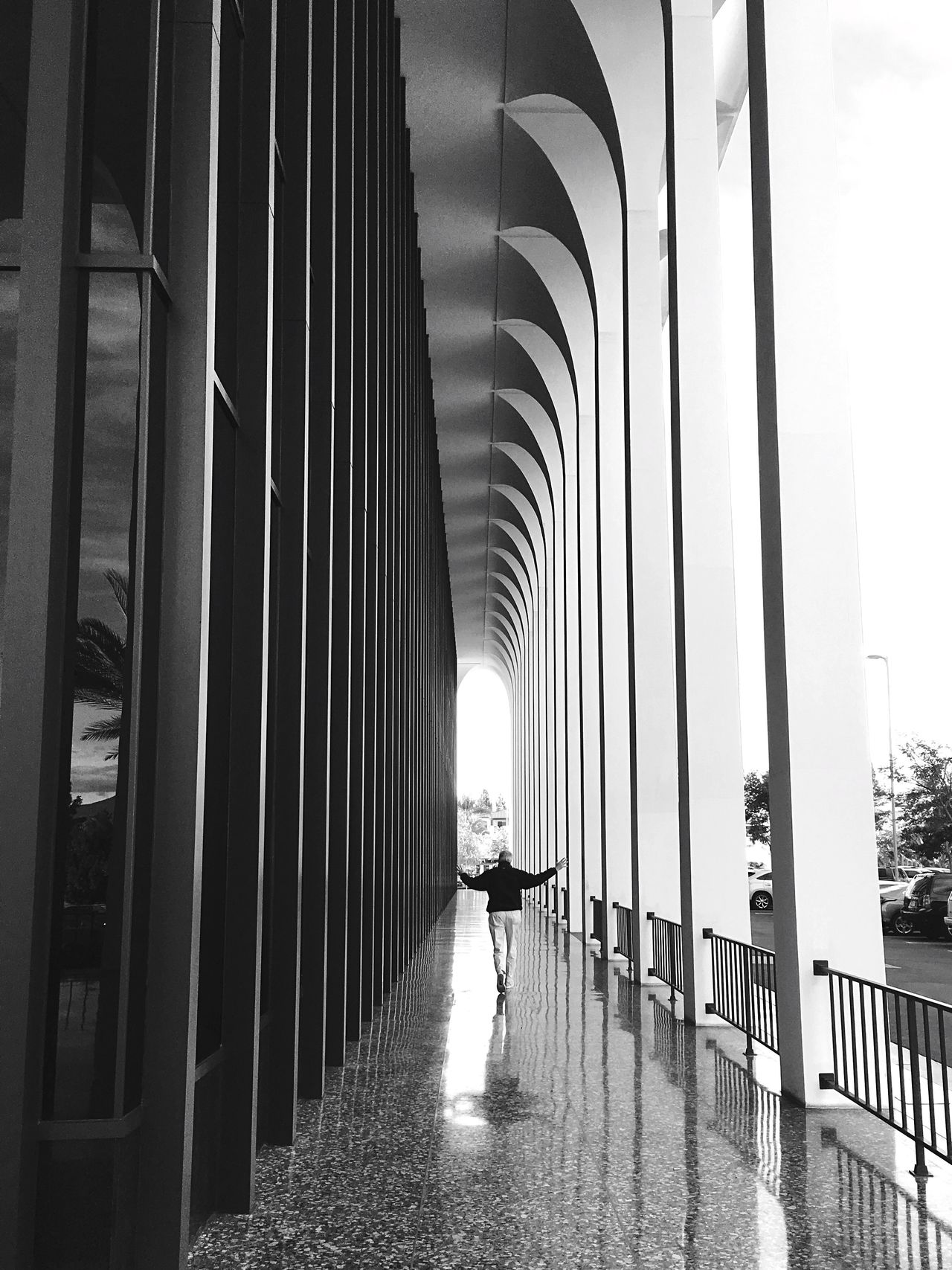 Arches and reflections Real People Full Length Lifestyles Architecture Built Structure Rear View One Person Walking Indoors  Arches Sixties Style Public Places Architecturephotography Architectural Column B&w Street Photography Streetphotography dDay tThe Way Forward Reflections And Shadows