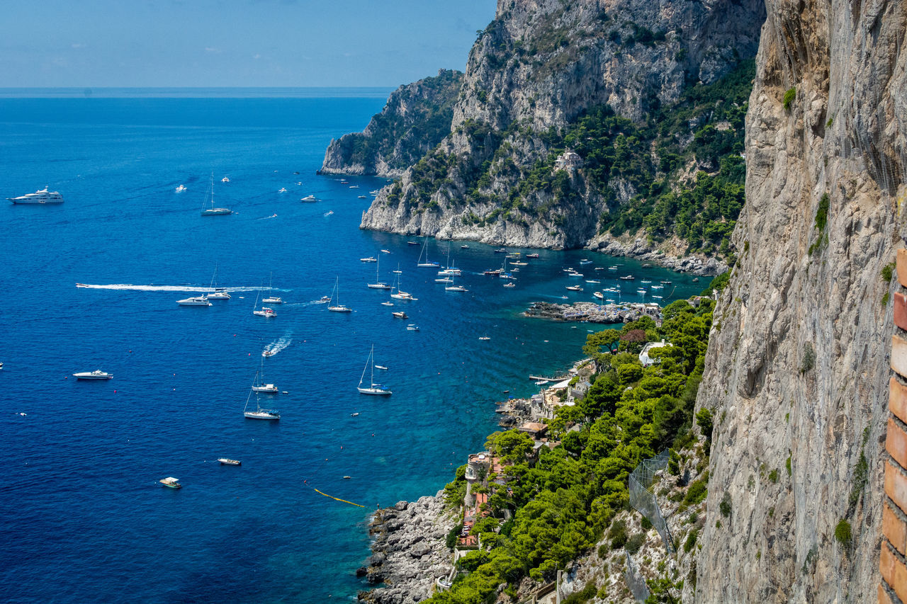 Beauty In Nature Blue Boat Capri Capri, Italy Cliff Coastline Day Harbor High Angle View Italy Mode Of Transport Nature Nautical Vessel Plant Scenics Sea Shore Sky Tourism Tranquil Scene Tranquility Transportation Travel Water