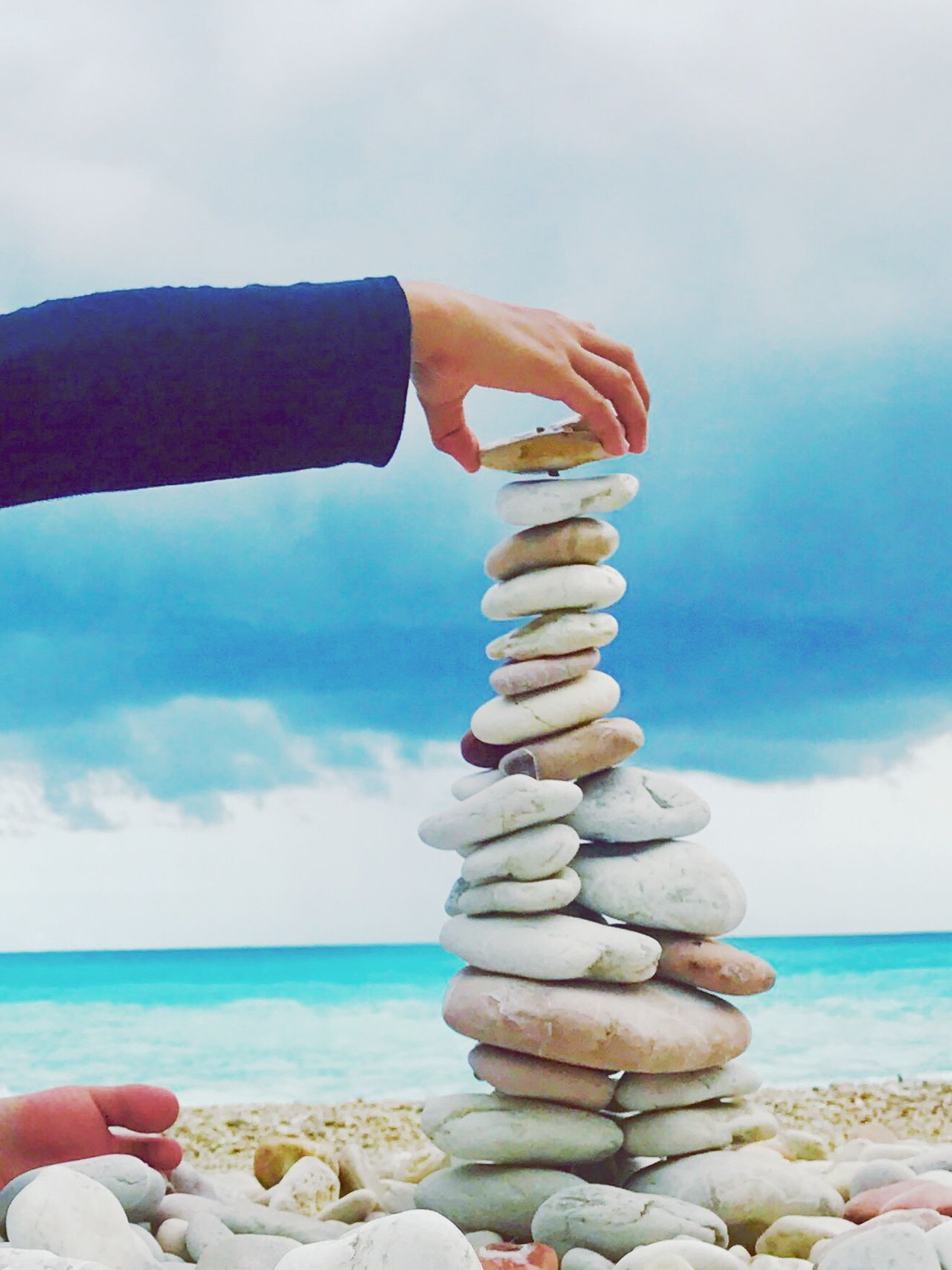 Stack Water Sea Human Hand Beach Leisure Activity Cloud - Sky Outdoors Nature Stone - Object Playing Playing Outside Personal Perspective