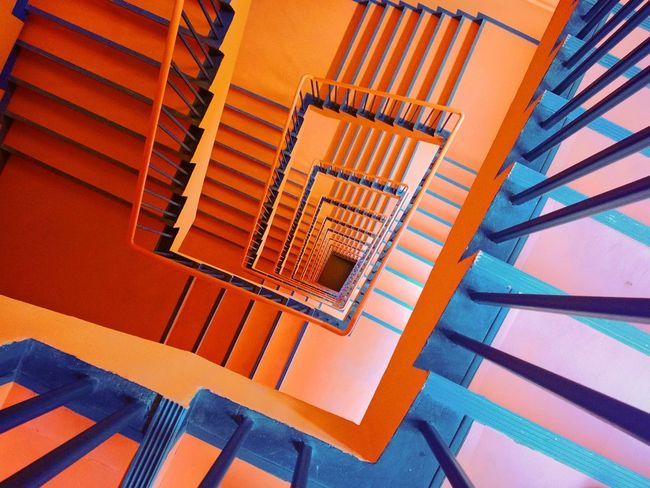 Architectural Feature Architecture Blue Building Built Structure Close-up Day Design Diminishing Perspective Directly Below Empty Modern No People Orange Color Repetition Spiral Stairs Yellow