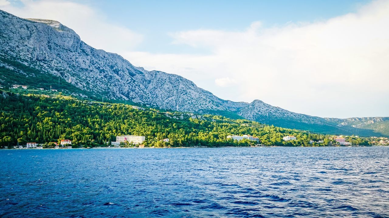 Orebic Hotels Hotels And Resorts Tranquil Scene Mountain Water Scenics Waterfront Tranquility Lake Calm Beauty In Nature Cloud Sky Idyllic Rippled Blue Nature Mountain Range Solitude Non-urban Scene Sea Remote Coastline