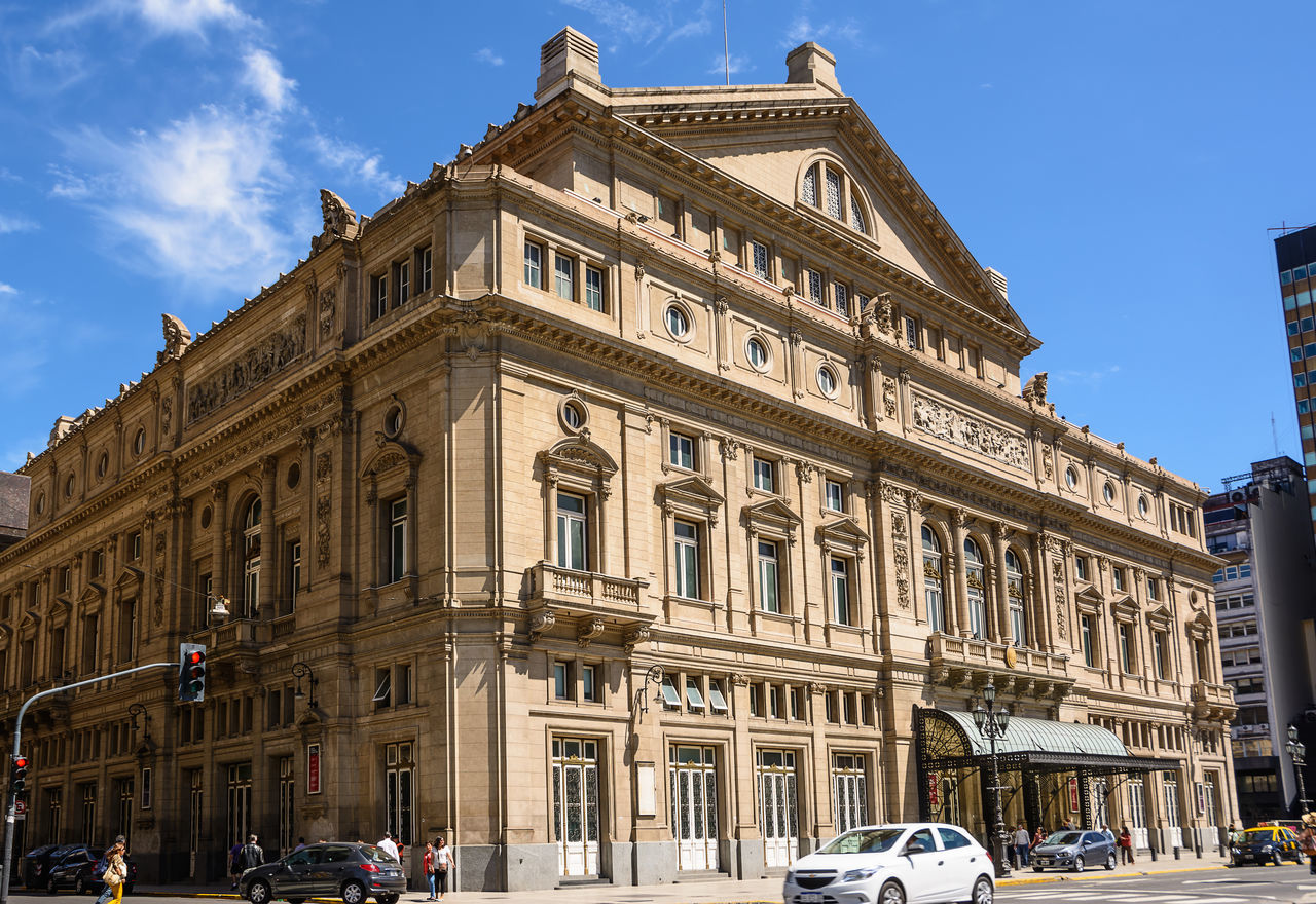 , Argentina - October 30, 2016: Facade of the Teatro Colon in Buenos Aires and traffic in the street America Architecture Argentina Buenos Aires Building Capital Capital Federal Cars City Ciudad Autónoma De Buenos Aires Colon Columbus Landmark Metropolis NeoClassicism Opera House Sightseeing Street Theater Theatre Traffic Travel Urban Venue