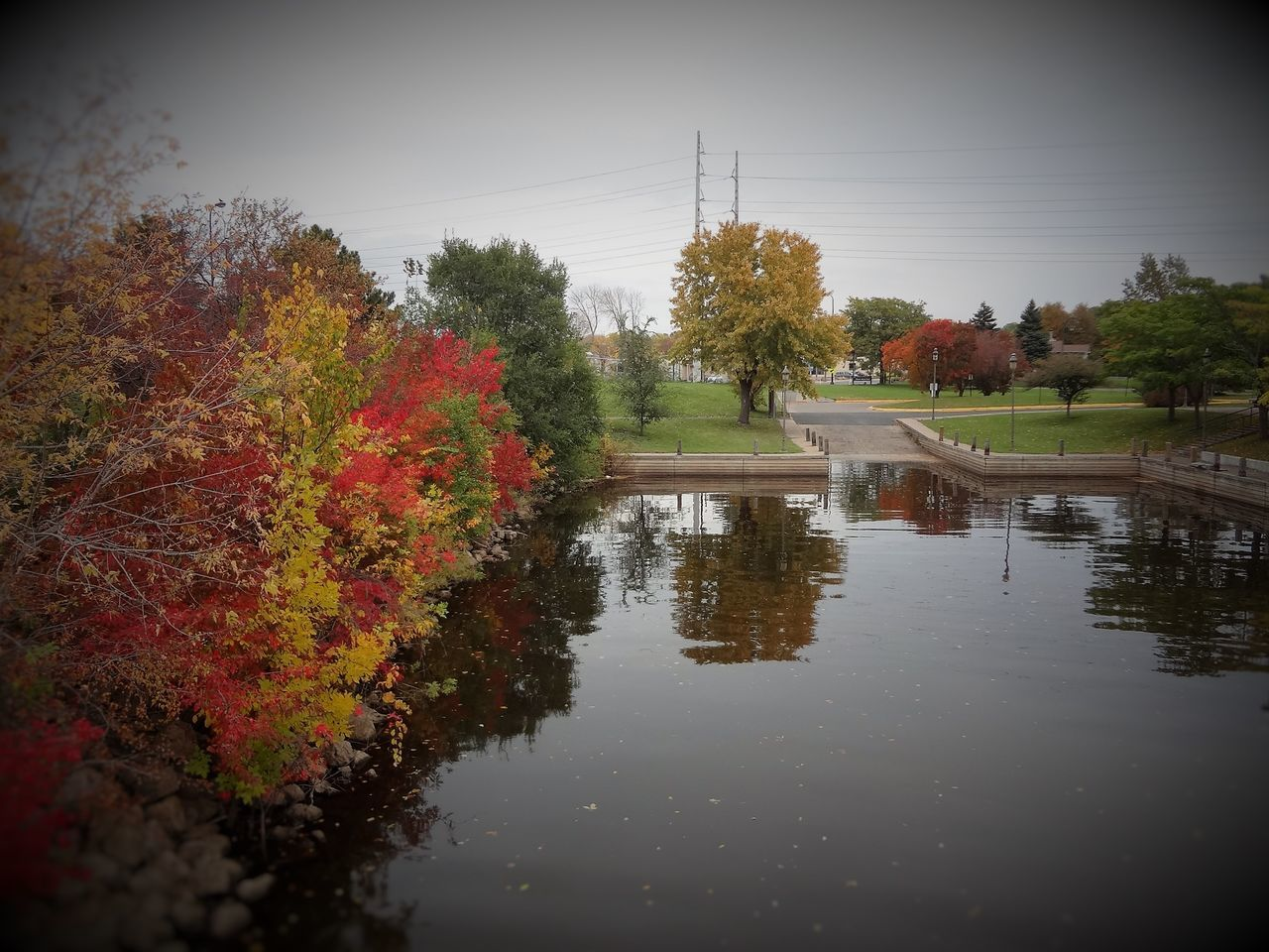 Boom Island, Northeast Minneapolis, MN. Beauty In Nature Day Fall Collection Fall Colors Fall Leaves Growth Nature No People Outdoors Reflection Reflesh Sky Tabphotography Tree Water Water Reflections