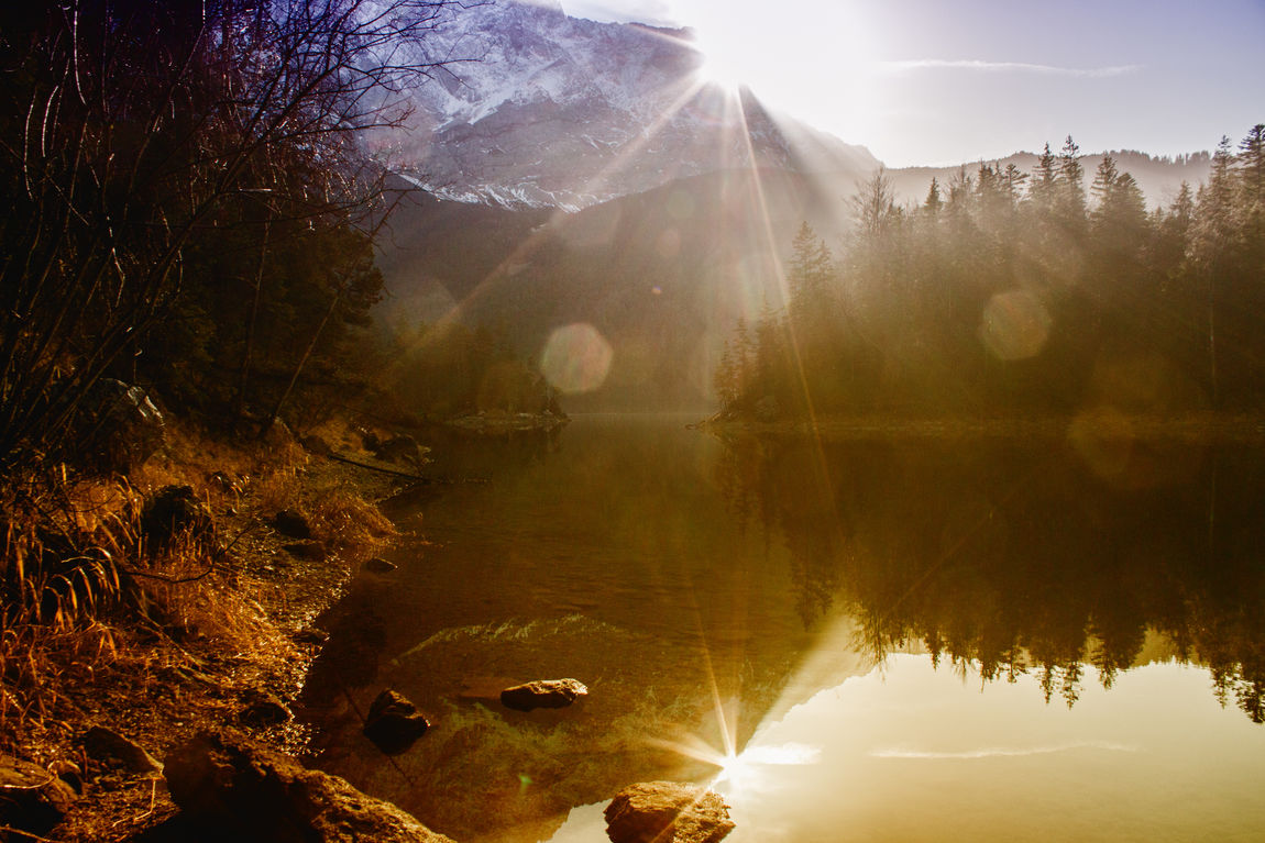 Bavaria Beauty In Nature Day Eibsee Garmisch Landscape Lens Flare Mountain Nature No People Outdoors Reflection Scenics Silhouette Sky Solar Flare Sun Sunbeam Sunlight Sunset Tree Water