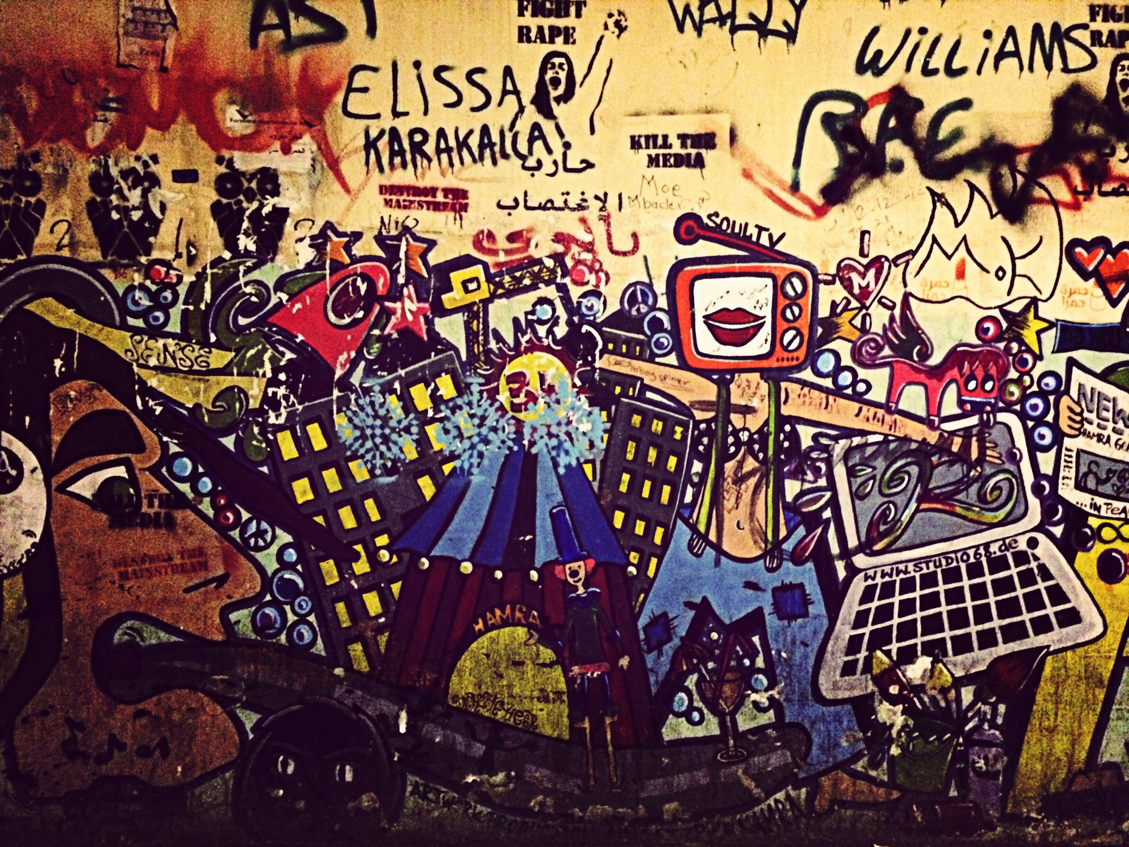 graffiti, text, art, art and craft, creativity, indoors, wall - building feature, western script, built structure, communication, architecture, pattern, design, multi colored, wall, non-western script, no people, street art, day, full frame