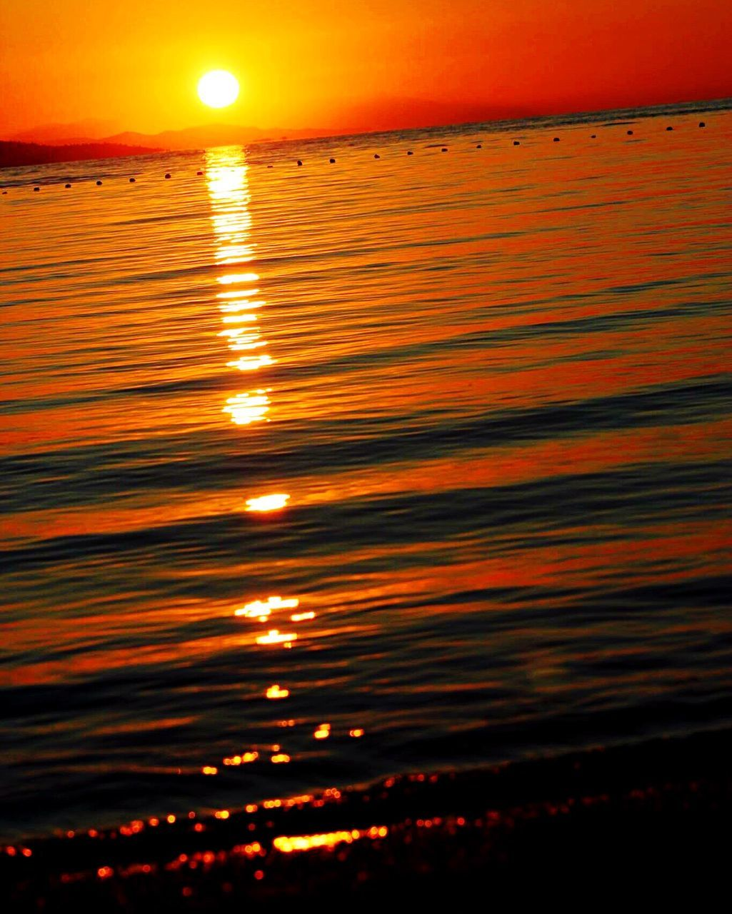 sunset, sea, water, reflection, beauty in nature, scenics, nature, orange color, tranquil scene, sun, tranquility, beach, outdoors, no people, sky, horizon over water, rippled, waterfront, horizon, close-up