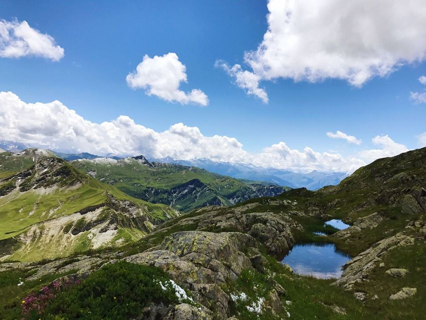 Alps Rhône Alpes Mountain Sky Nature Scenics Tranquil Scene Beauty In Nature Cloud - Sky Tranquility Day Outdoors High Angle View Mountain Range Water No People Landscape Blue Grass