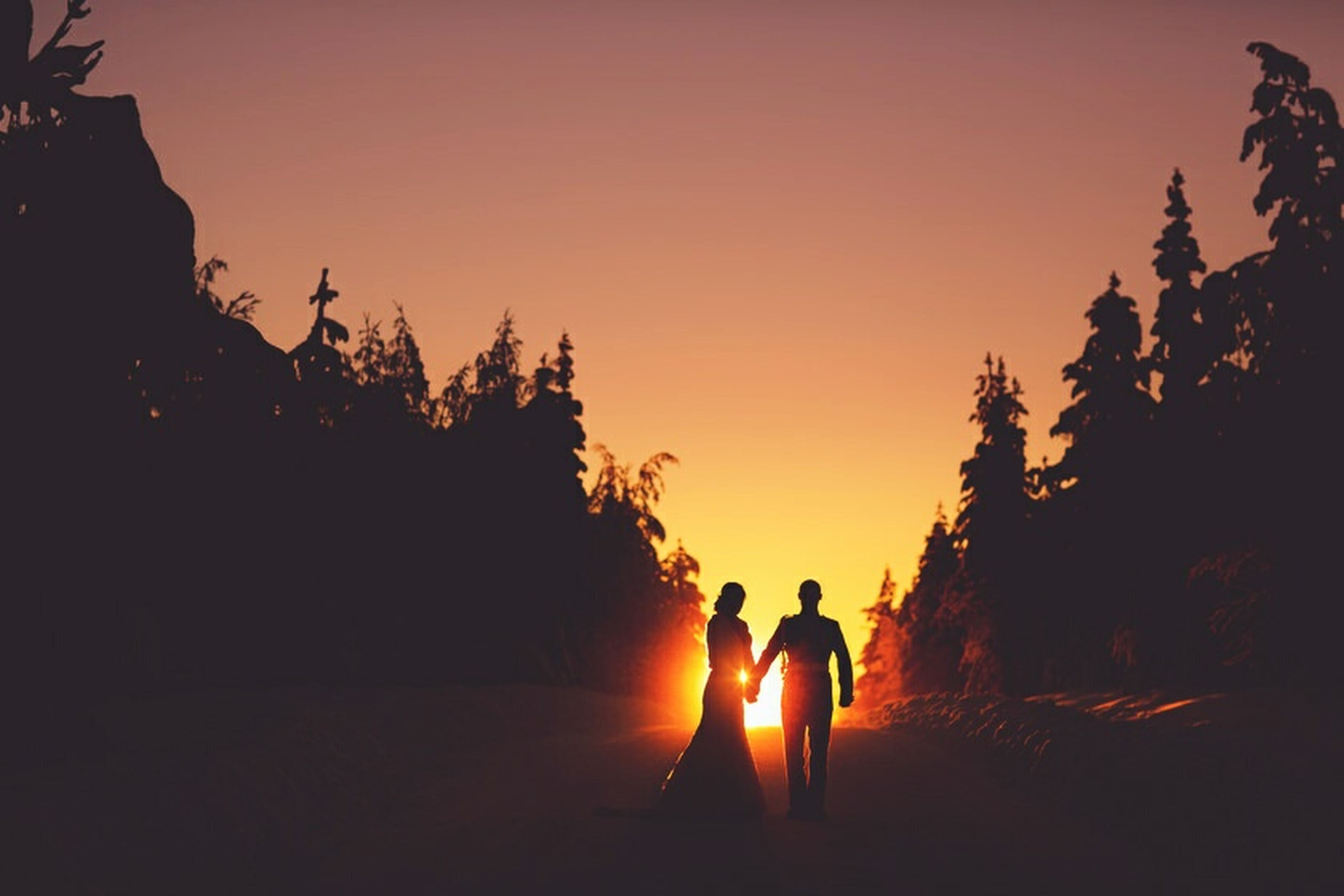 sunset, silhouette, child, two people, bonding, togetherness, full length, nature, senior adult, men, beauty in nature, adult, people, vacations, friendship, outdoors, young adult, adults only, sportsman, sky