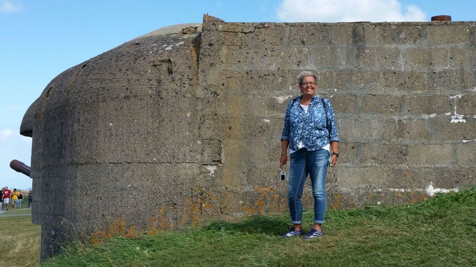 France Batterie Longues Sur Mer Casual Clothing Front View One Person Full Length Adults Only Outdoors Day Only Women Clear Sky Grass D-Day Beaches August 2016 Portrait Smiling Standing One Woman Only Summerfeeling Summertime Looking At Camera Memorial Memorial Of World War Two Windy Day Woman Portraiture