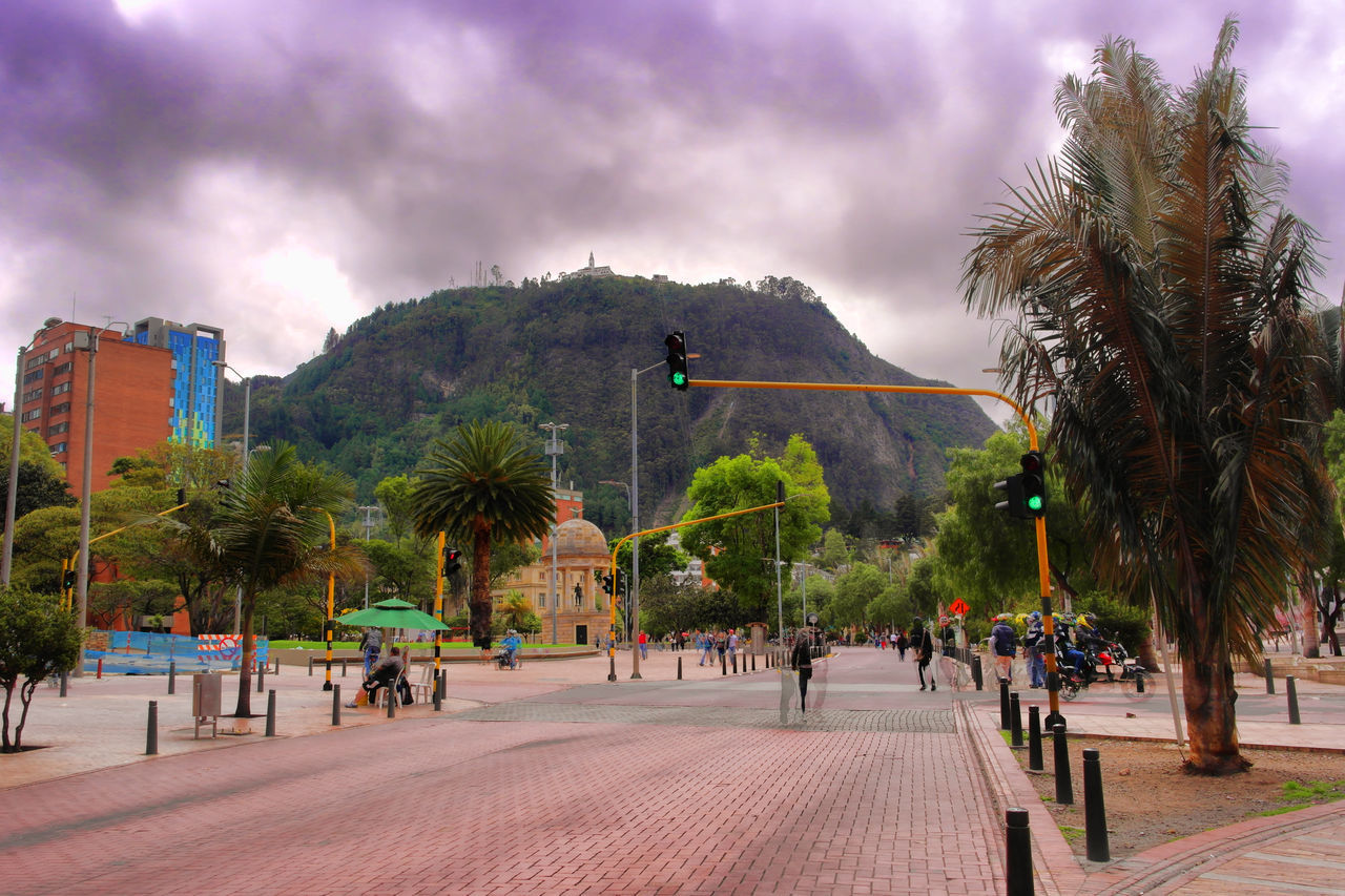 Architecture Built Structure Cerros Orientales City Life Cloud Cloud - Sky Cloudy Day Grass Green Color Growth Large Group Of People Leisure Activity Lifestyles Mixed Age Range Monserrate, Bogotá Nature Outdoors Overcast Sky Tourism Travel Destinations Tree Weather