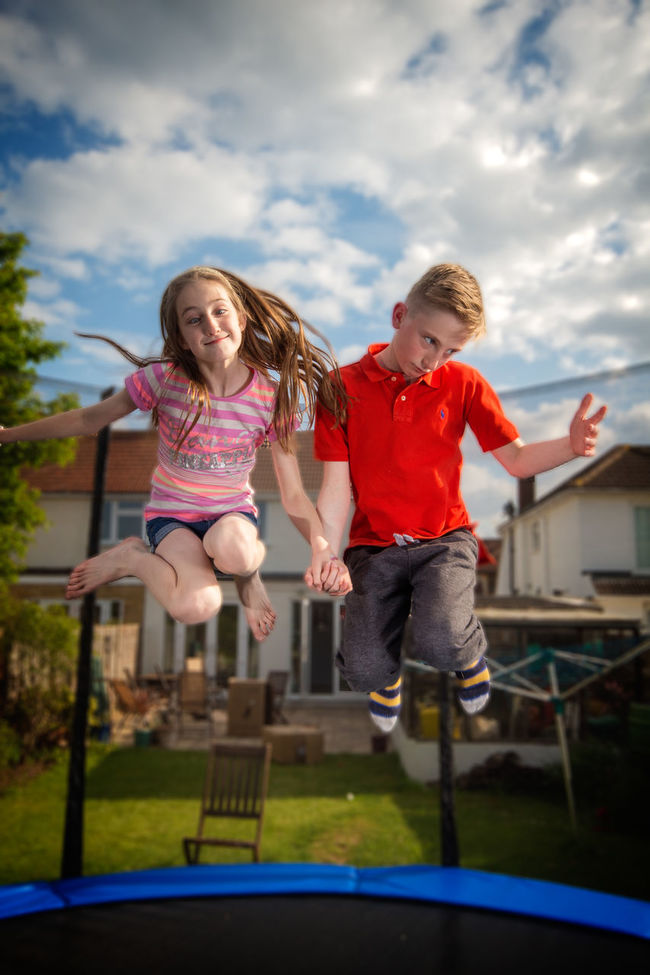 The kids love their trampolice BOUNCE Boys Childhood Cloud Cute Day Enjoyment Family Flash Flash Photography Fun Girls Jump Jumping Playground Pulling Faces  Sky Trampoline Trampoline Photography