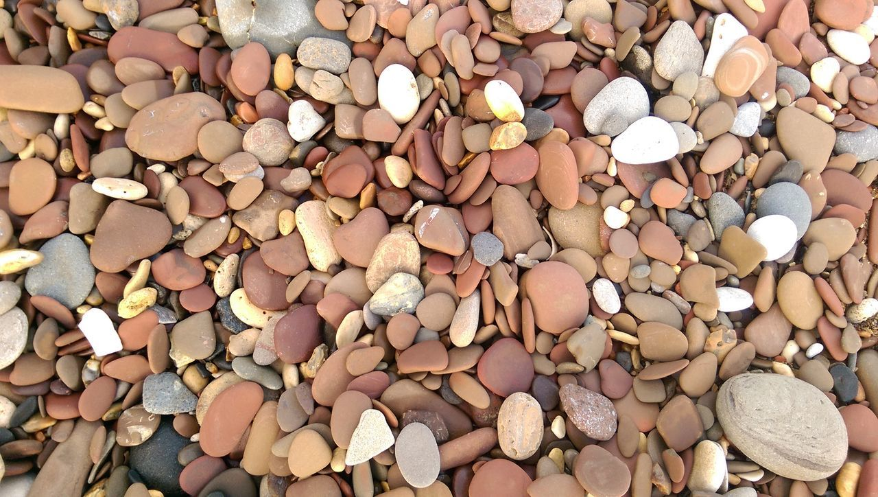 Pebbles On A Beach Outdoors Stones Set In Time Summer Colours And Patterns Nature EyeEmNewHere EyeEmNewHere