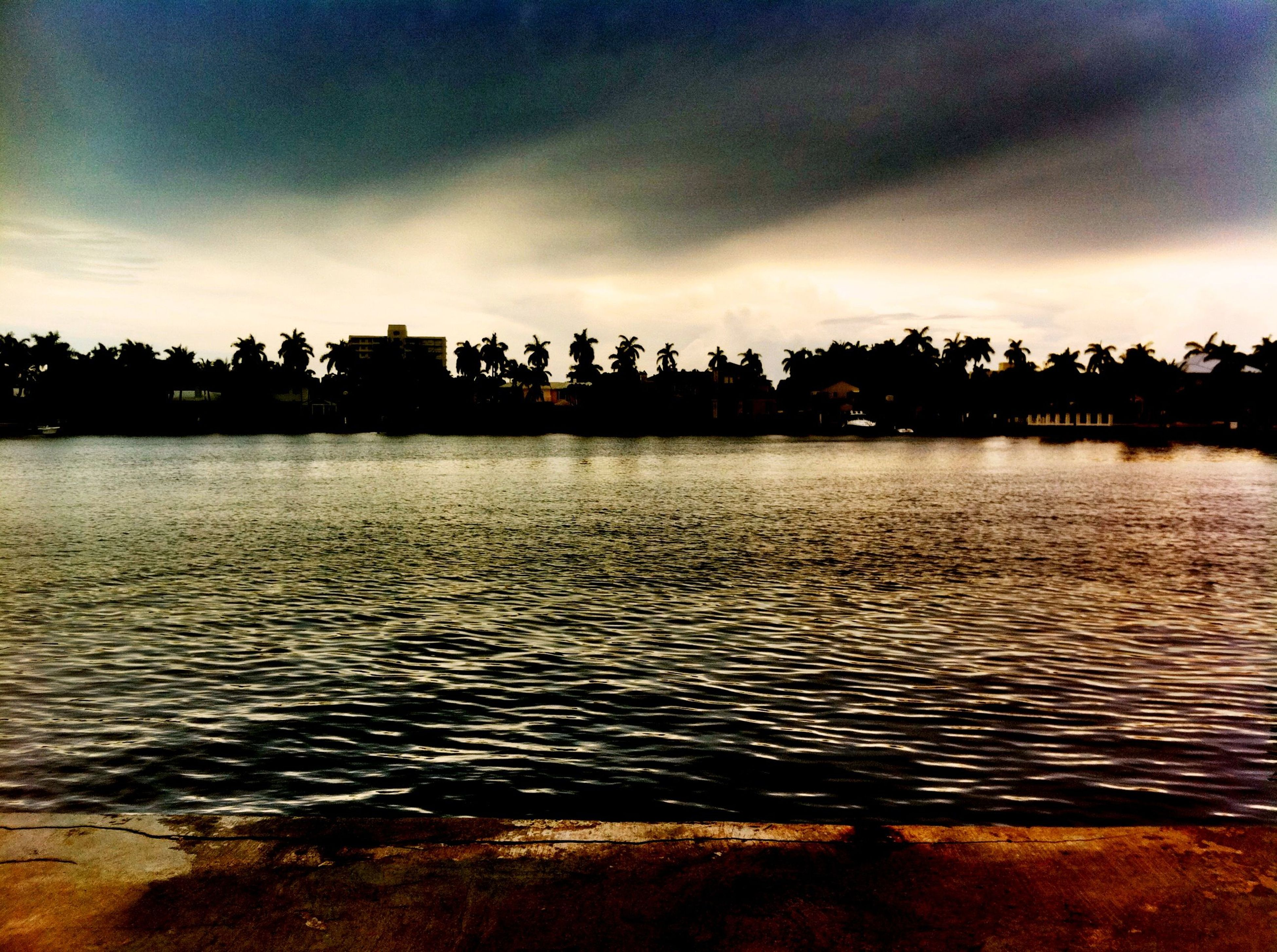 water, sky, cloud - sky, waterfront, scenics, tranquil scene, silhouette, tranquility, sunset, beauty in nature, rippled, cloudy, dusk, reflection, tree, lake, nature, cloud, river, illuminated
