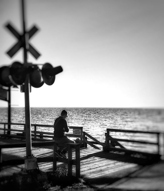 Sea Water Sitting Horizon Over Water Silhouette Rear View Men Bench Solitude Leisure Activity Tranquil Scene Tranquility Waiting Clear Sky Relaxation Vacations Scenics Outdoors Remote Non-urban Scene Bridge - Man Made Structure Calm Tranquility Tourism Idyllic