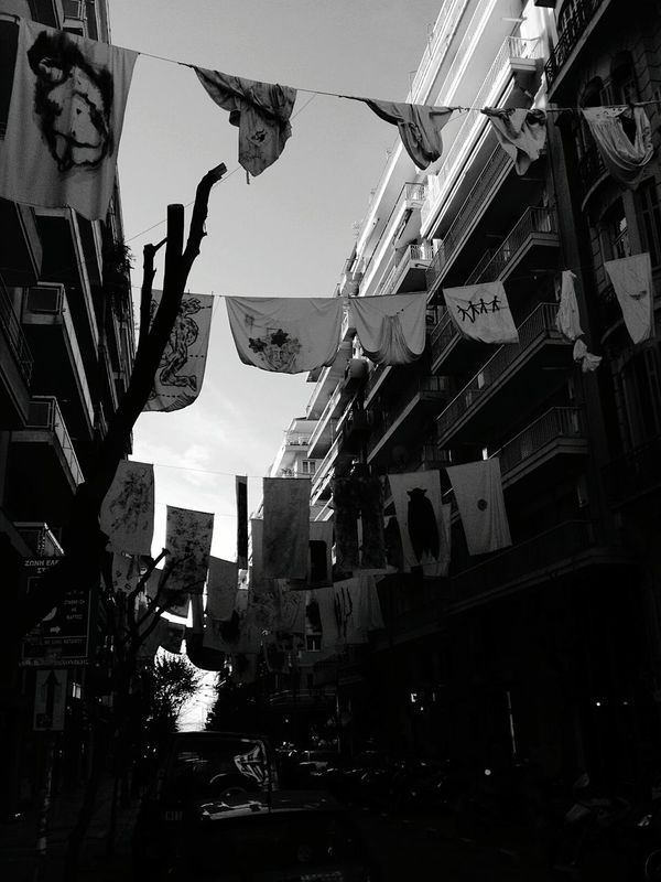 Thessaloniki Greece Art Hanging White Clothes On Building Painting Artistic Weird Stuff But Beautiful Caltural Capital For Ever Beautiful Day Urban Lifestyle Street Photography Walking Around The City  Blackandwhite Photography Black And White Photography Black & White Blackandwhite