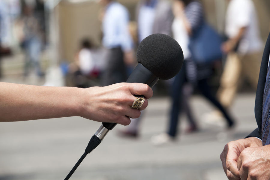 Media interview Journalist Mic Press Reporting Answer Answering Asking Questions Broadcasting Journalism Comment Communication Holding Human Hand Journalism Media Media Event Media Interview Microphone News News Conference People Press Conference Press Interview Question Report Reporter