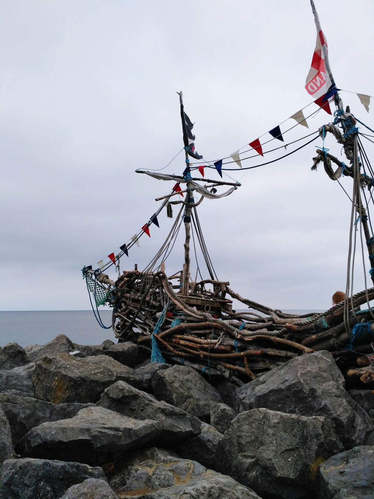 Pirate Pirate Ship Pirateship  Pirates Of The Caribbean Flag Pirate Flag Woodenboats Beach Nopeople Sea Fishing Net Sky Buoy Horizon Over Water Day Outdoors Water Nature No People Tall Ship