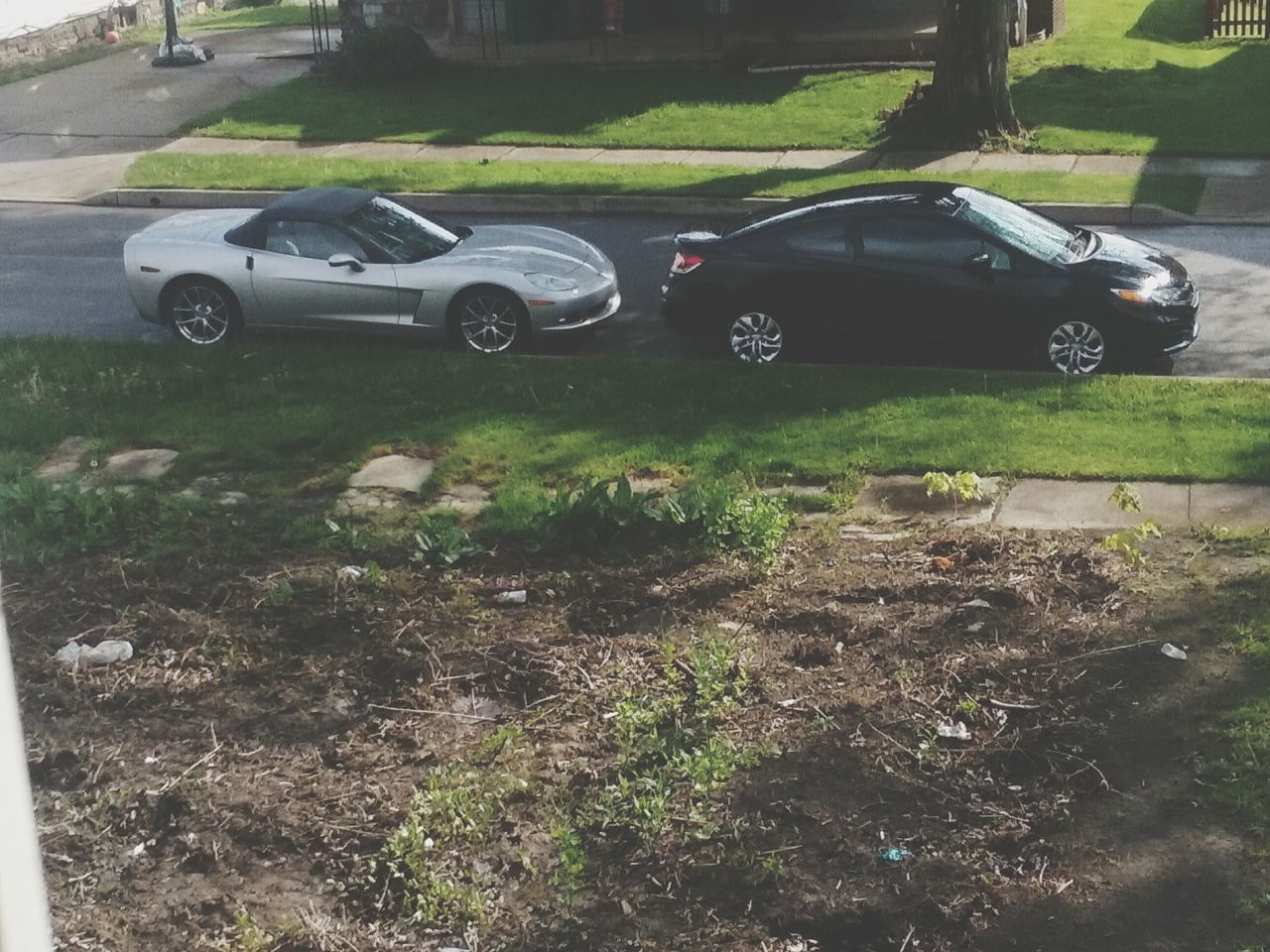 car, transportation, land vehicle, day, no people, grass, outdoors