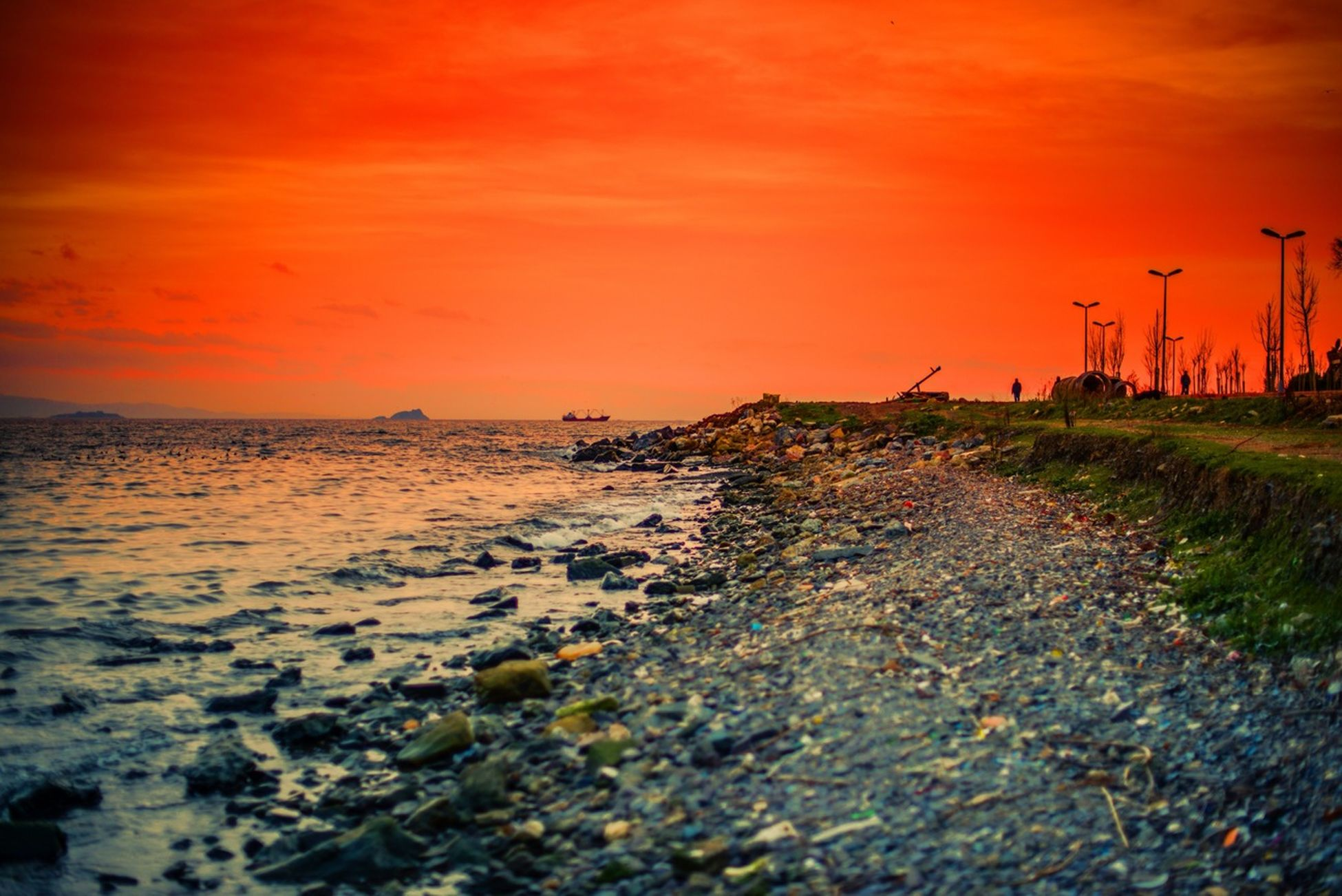 sunset, orange color, water, sea, scenics, tranquil scene, tranquility, sky, beauty in nature, beach, nature, idyllic, shore, horizon over water, outdoors, non-urban scene, remote, dusk, rock - object, no people