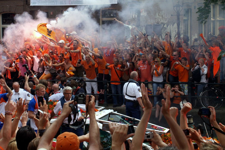 Adult Amsterdam Arjen Robben Boat Can Celebration Ceremony Crowd Cultures Dutch Dutch Soccer Team Large Group Of People Law Lifestyles Men Orange Outdoors Place Of Worship Real People Religion Robben  Soccer Traditional Ceremony World Champion World Championship Soccer 2010