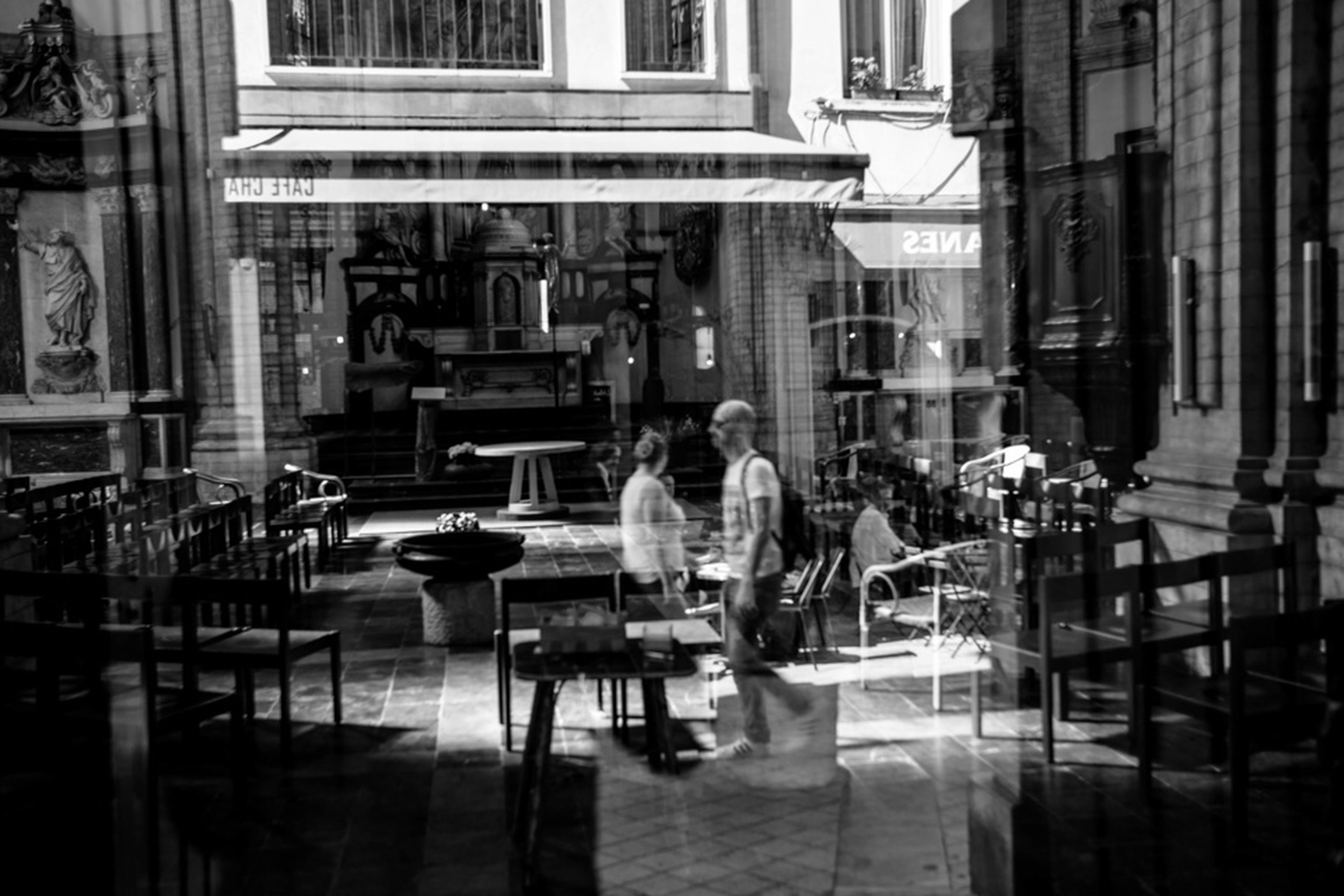 real people, building exterior, architecture, reflection, built structure, chair, table, window, women, day, lifestyles, sitting, outdoors, full length, men, city, one person, people