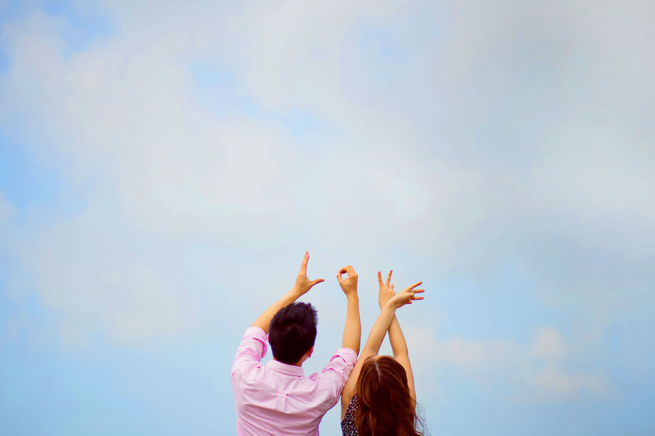 Beautiful stock photos of sign, Arms Raised, Bonding, Couple - Relationship, Day