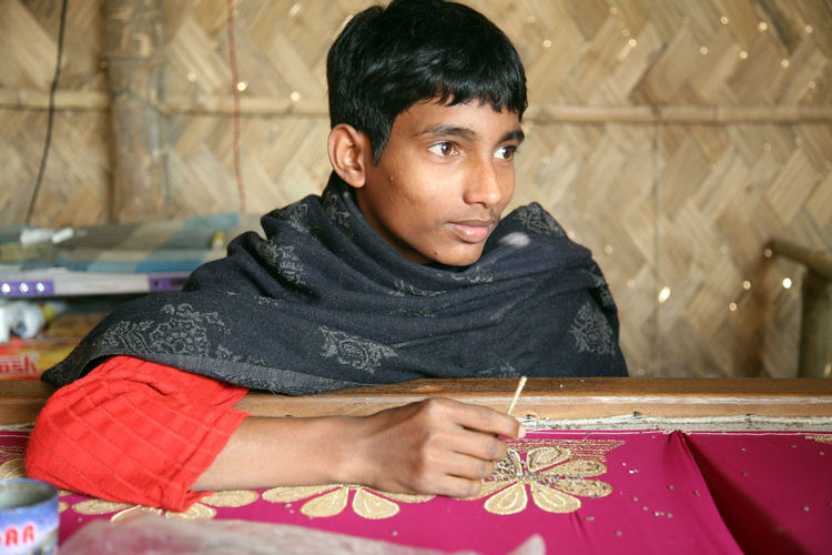Child workers working on the decoration of textiles in Kumrokhali, India on Jan 16, 2009. Child Children Employment India Job Kid Kumrokhali Laborer Person Poor  Poverty Teenager Textile Underpaid West Bengal Worker Young Adult
