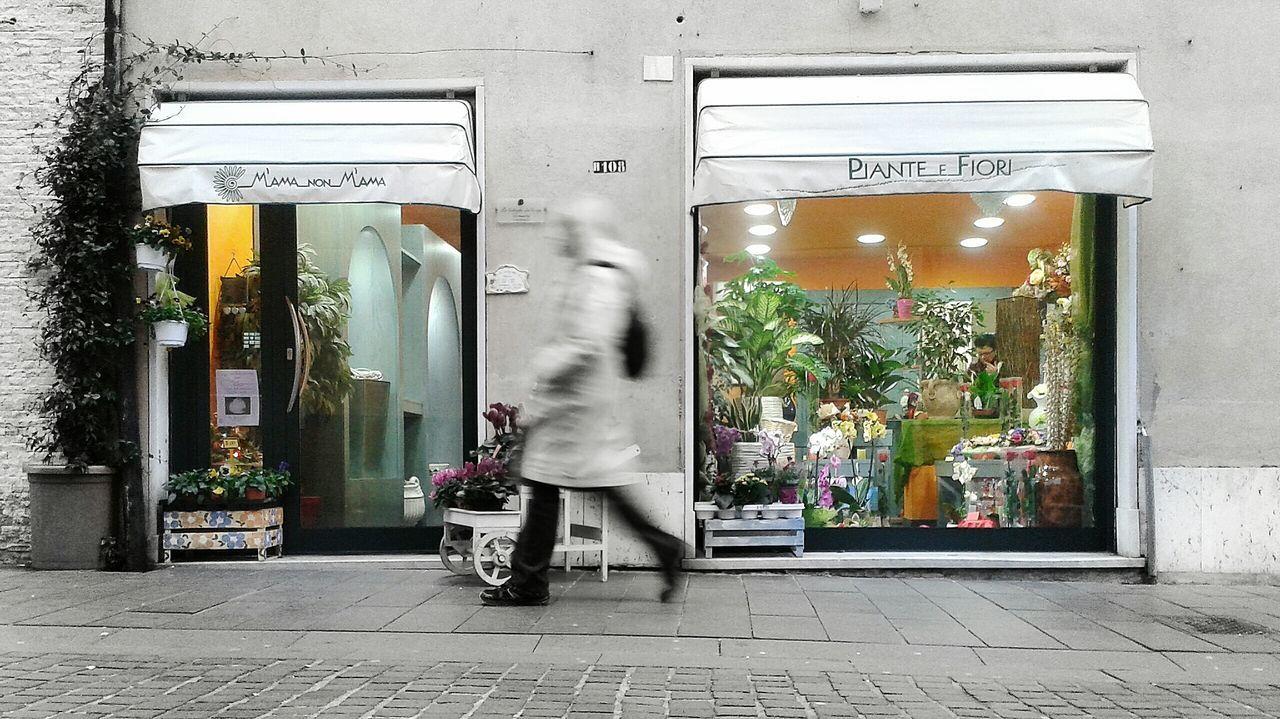 """Flowers Shop - Long exposure & Color Splash"". Street Photography Motion Blur Shop Vetrine Storefront Shop Window Passanti Colour Splash /quick Color Splash with Snapseed / Smartphone Photography with S3mini / Camera FV-5 / EyeEm Enhance button"
