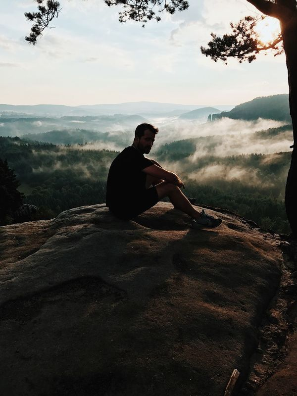Edge Case One Person Real People Sitting Men Nature Day Mountain Range Landscape Adventure Sky Beauty In Nature Outdoors One Man Only Tree Only Men Adult People
