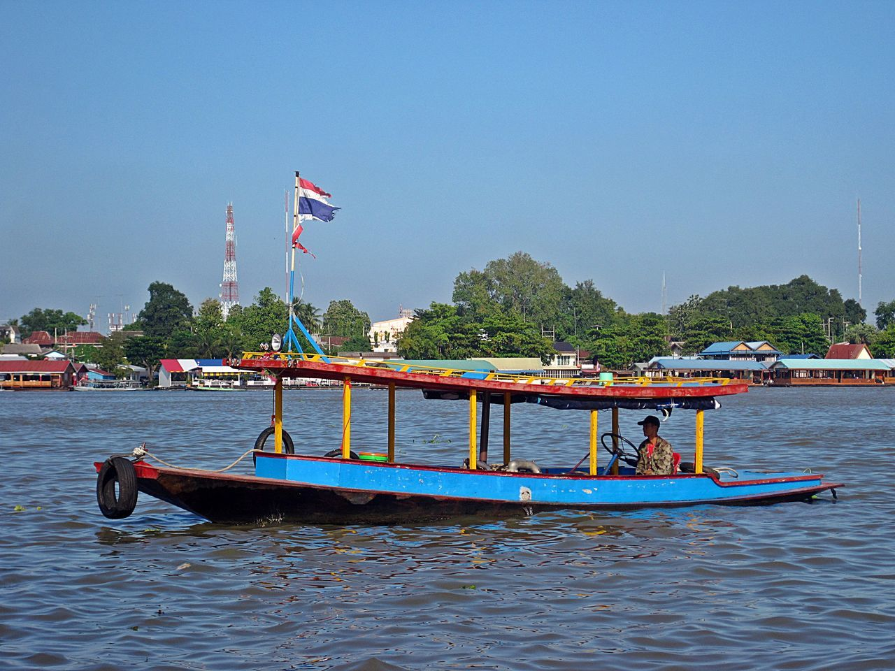flag, transportation, patriotism, mode of transport, nautical vessel, day, water, blue, outdoors, moored, waterfront, no people, clear sky, nature, sky