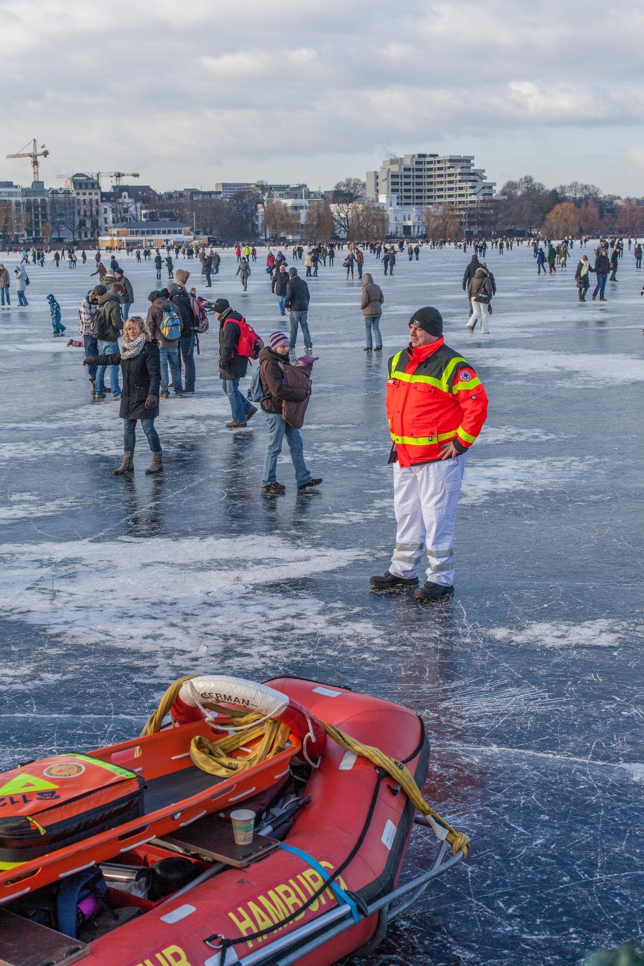 Adventure Alster Ambulance Boat Ambulance Staff City Cityscape Day Hamburg Ice Ice Skating Outdoors People Water Winter