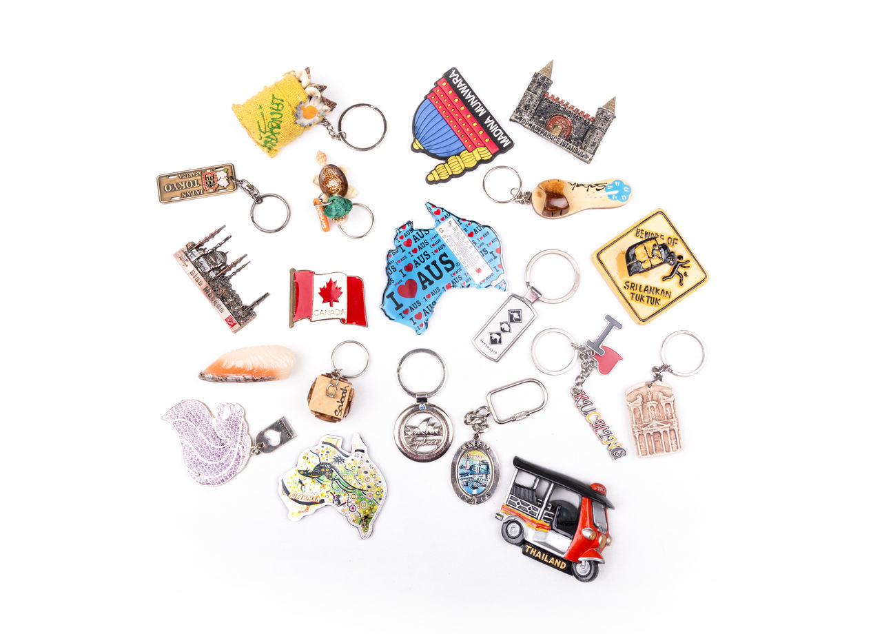 Various souvenir key chains and fridge magnet around the world on a white background Arab ASIA Australia Canada Collection Colorful Country Destination Europe Fridge Magnets Italia Japan Key Chain Malaysia Middle East Multi Colored Singapore Sri Lanka Thailand Travel Travel Destinations Trip Turkey White Background World