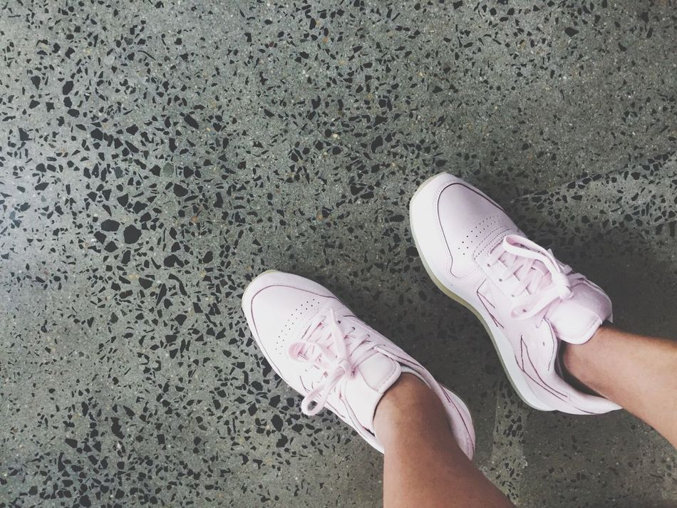 Millennial Pink shoes on cement floor Shoe Personal Perspective Lifestyles High Angle View Real People Sneakers Pastel Power Concrete Floor Cement Grey