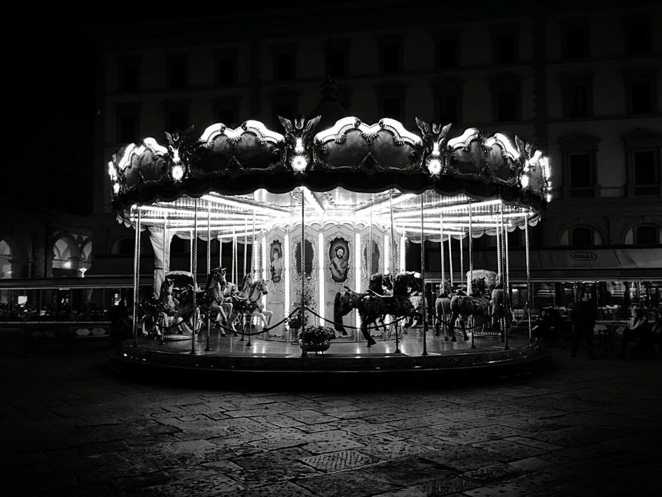 Amusement Park Arts Culture And Entertainment Carousel Amusement Park Ride Illuminated Night Architecture Merry-go-round Outdoors City People Built Structure Backgrounds Travel Beauty Aesthetic Theatrical Performance No People Realism Symmetry Animal Themes