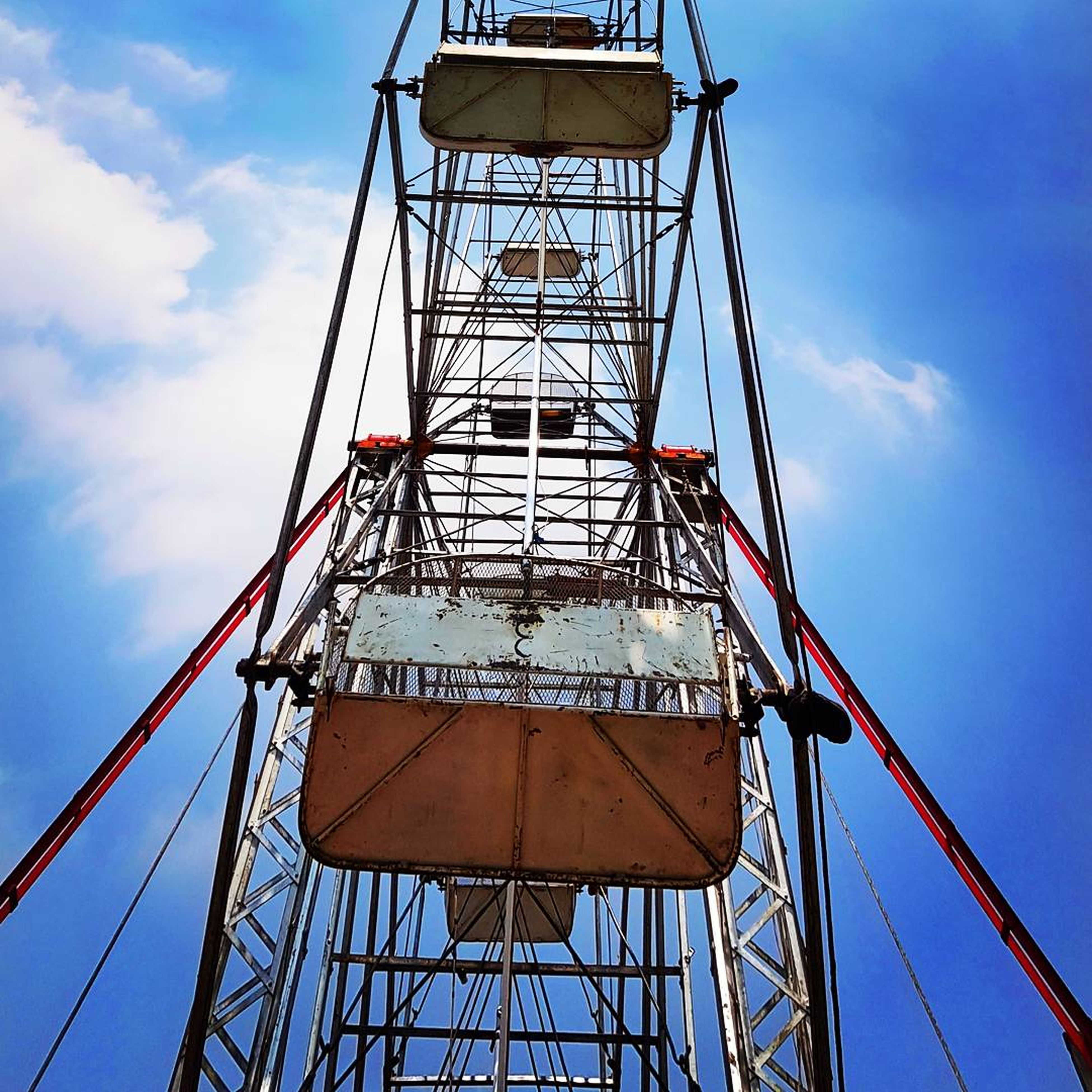 sky, low angle view, cloud - sky, built structure, day, architecture, lookout tower, blue, outdoors, no people, water tower - storage tank