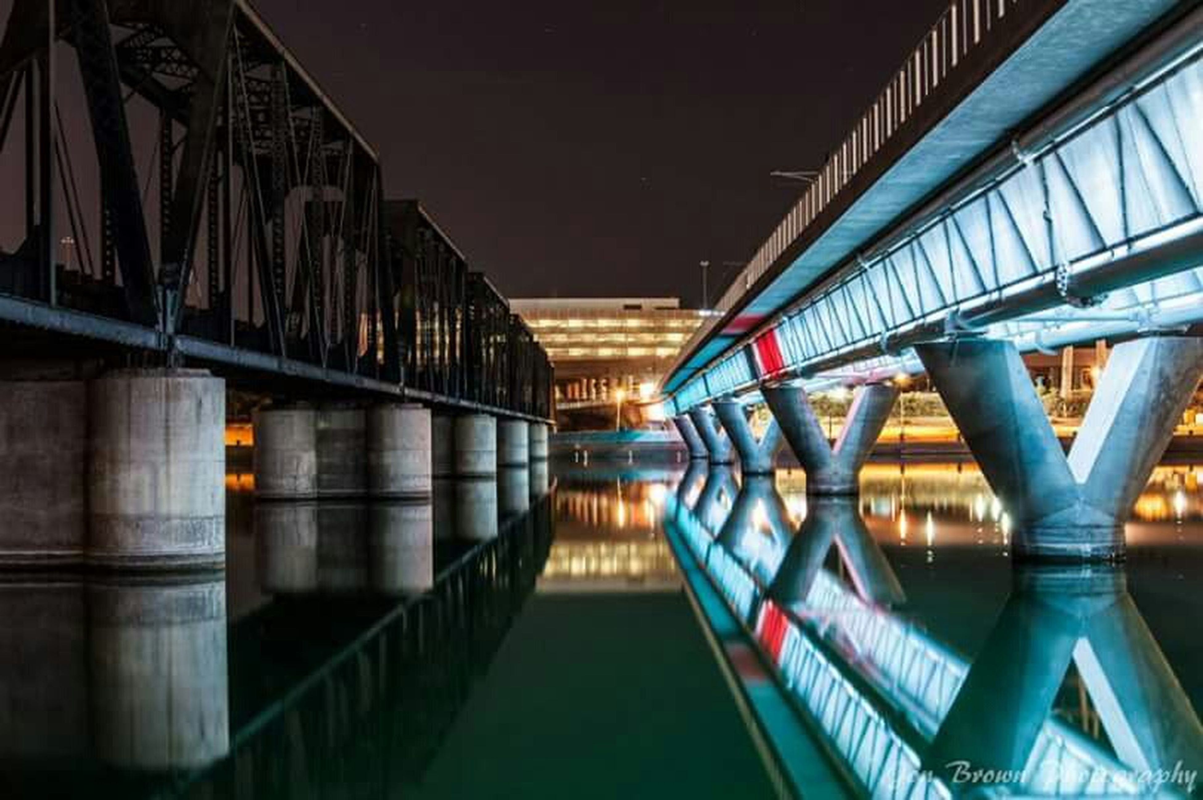 architecture, built structure, bridge - man made structure, connection, the way forward, indoors, railing, diminishing perspective, illuminated, long, bridge, footbridge, engineering, ceiling, low angle view, vanishing point, narrow, empty, reflection, no people
