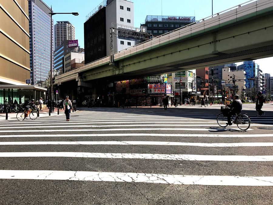 Let's Go. Together. Architecture Transportation City Built Structure Bridge - Man Made Structure Street Crossing City Street Walking City Life Road Building Exterior Connection Day Women Men Clear Sky Pedestrian Let's Go. Together.