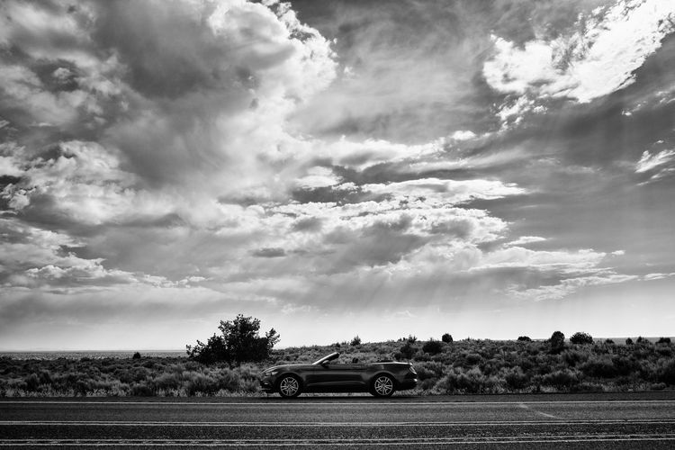 Big Sky Desert Ford Ford Mustang Freedom Car Clouds Convertible Convertible Car Desert Beauty Highway Land Vehicle Landscape Nature No People Outdoors Sky Sun Rays Transportation