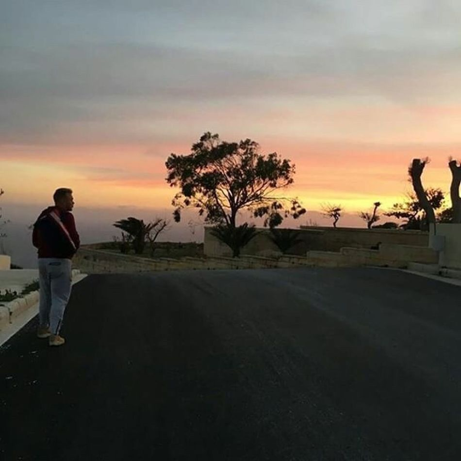 Sunset Tree Sky Full Length Real People One Person Nature Cloud - Sky Landscape Beauty In Nature Photographing Standing Road Scenics Men Outdoors Photography Themes Camera - Photographic Equipment Technology One Man Only My Man