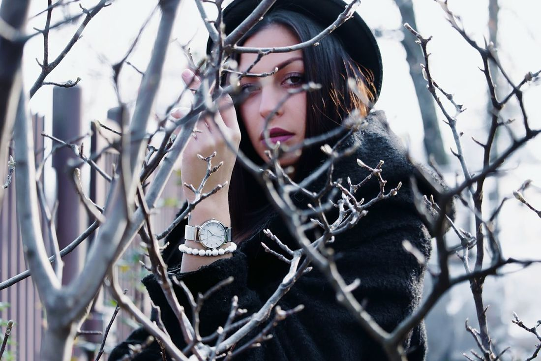 Young Adult One Person Adults Only Danger Adult Evil People Portrait Outdoors Watches Woman Portrait Of A Woman Tree Clock Nature Mood Pastel Winter Fashion Model Beauty In Nature Lady Girl Eyes Day Women Around The World The Portraitist - 2017 EyeEm Awards