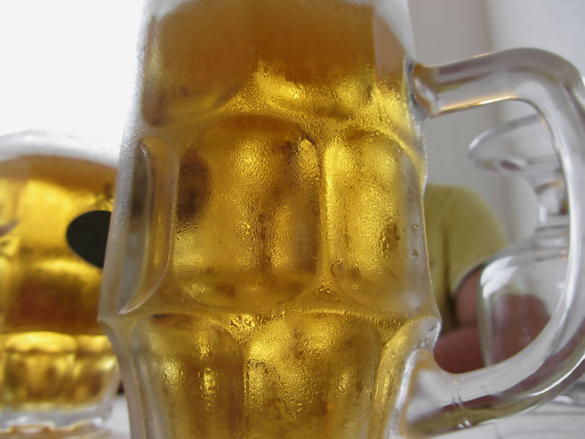 Cold mug of light beer on the table at a restaurant Alcohol Ale Bar Beer Beverage Bubbles Cold Condensation Drink Drip Drop Foam Frosty Froth Glass Jug Lager Light Liquid Mug Pint Pub Refreshment Restaurant Table