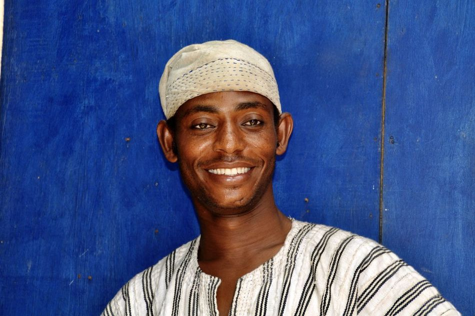 Portrait of a smiling young man Adult Blue Cheerful Close-up Front View Happiness Headshot Looking At Camera Man Muslim One Person Outdoors People Portrait Real People Smiling Young Adult