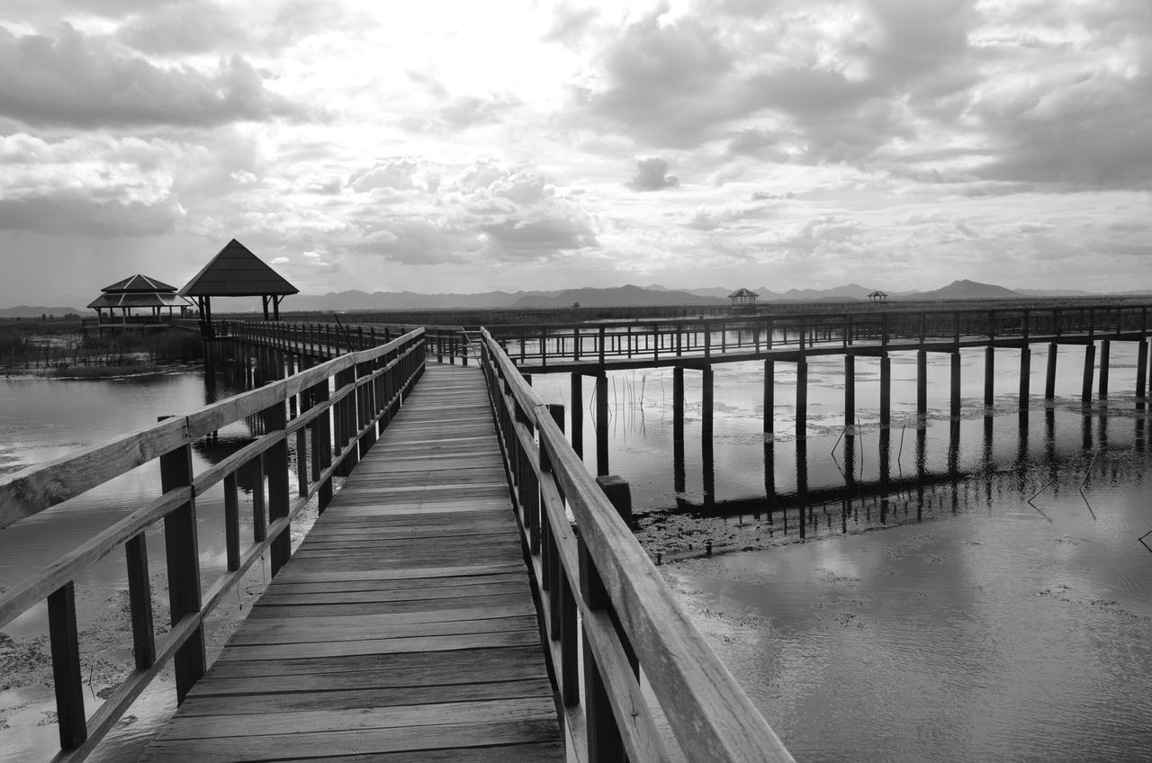water, sea, pier, sky, railing, jetty, cloud - sky, tranquility, tranquil scene, nature, built structure, outdoors, wood - material, horizon over water, day, scenics, no people, beauty in nature, beach, architecture, wood paneling, footbridge
