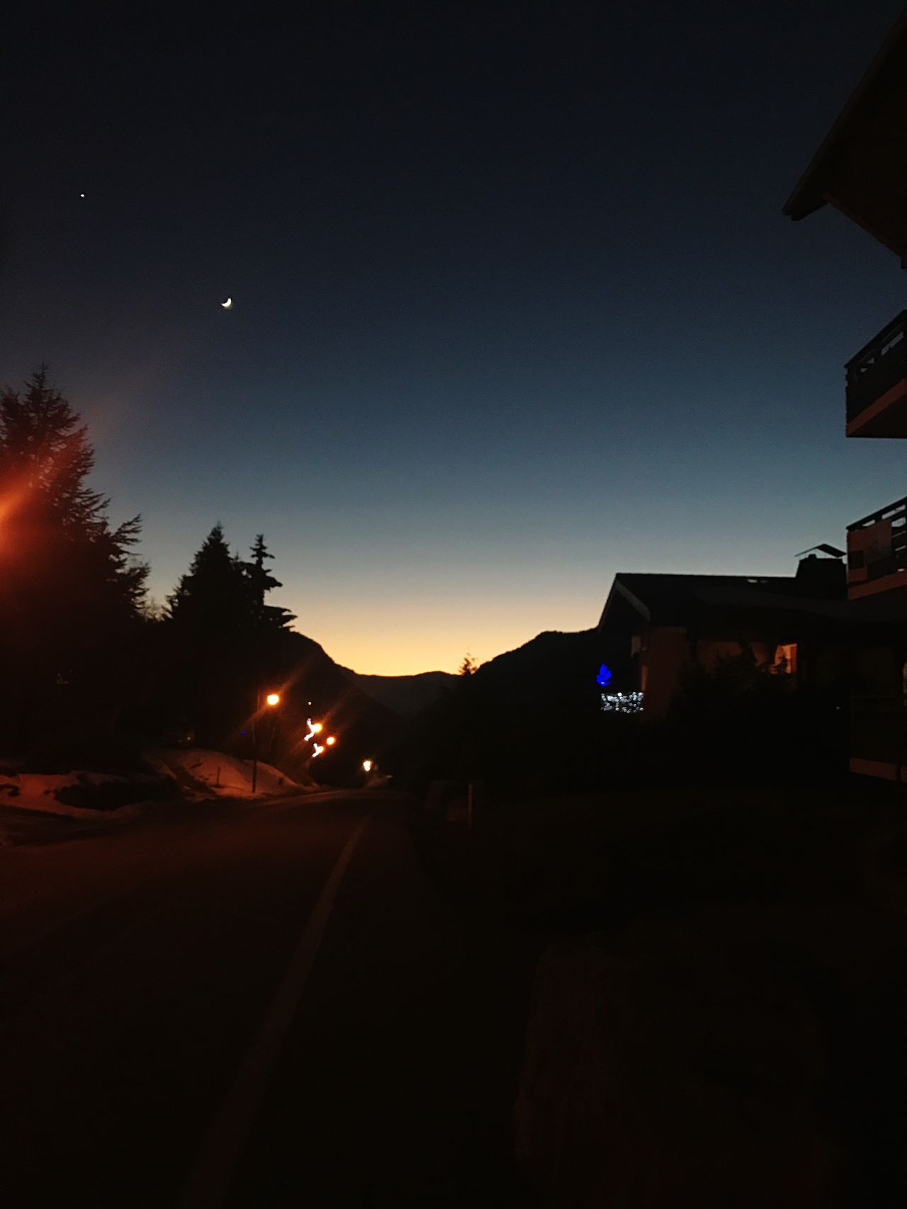 A single star and the moon above a beautiful sunset in the Alps Silhouette Night Dark Sunset Sky Road Outdoors No People Illuminated Nature Beauty In Nature (null)Skiing Morzine Nature Freshness Architecture