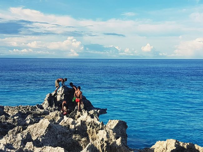 Sea Water Horizon Over Water Boys Sky Togetherness Day Seascape Fisherman Distant Rock Formation Scenics Vacations Biak Papua Indonesia