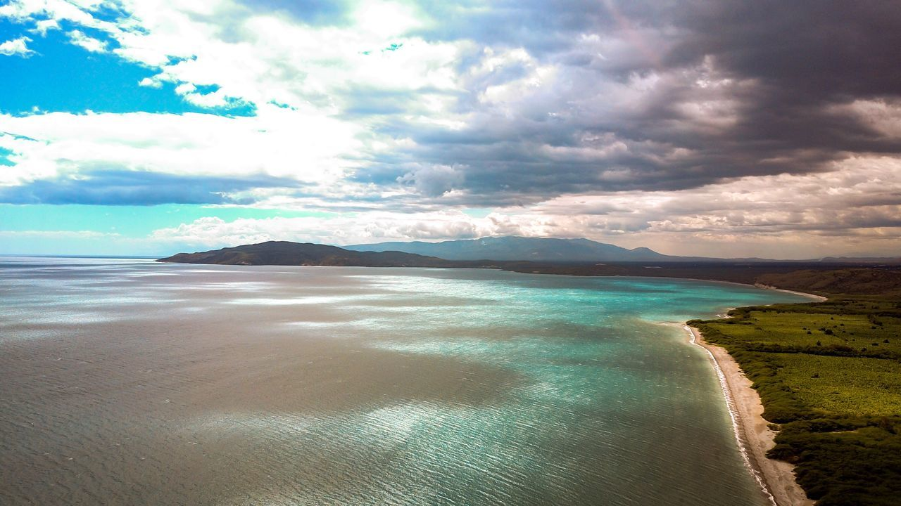 Paradise under the clouds! Beauty In Nature Sky Nature Tranquility Landscape Sea Beach No People Water Dramatic Sky Mountain Cloud - Sky EyeEmNewHere Beachphotography Oceanside Ocean View Beach Photography Photography Oceano Mar Sunlight Drone  Mavic Aerial Photography Santo Domingo