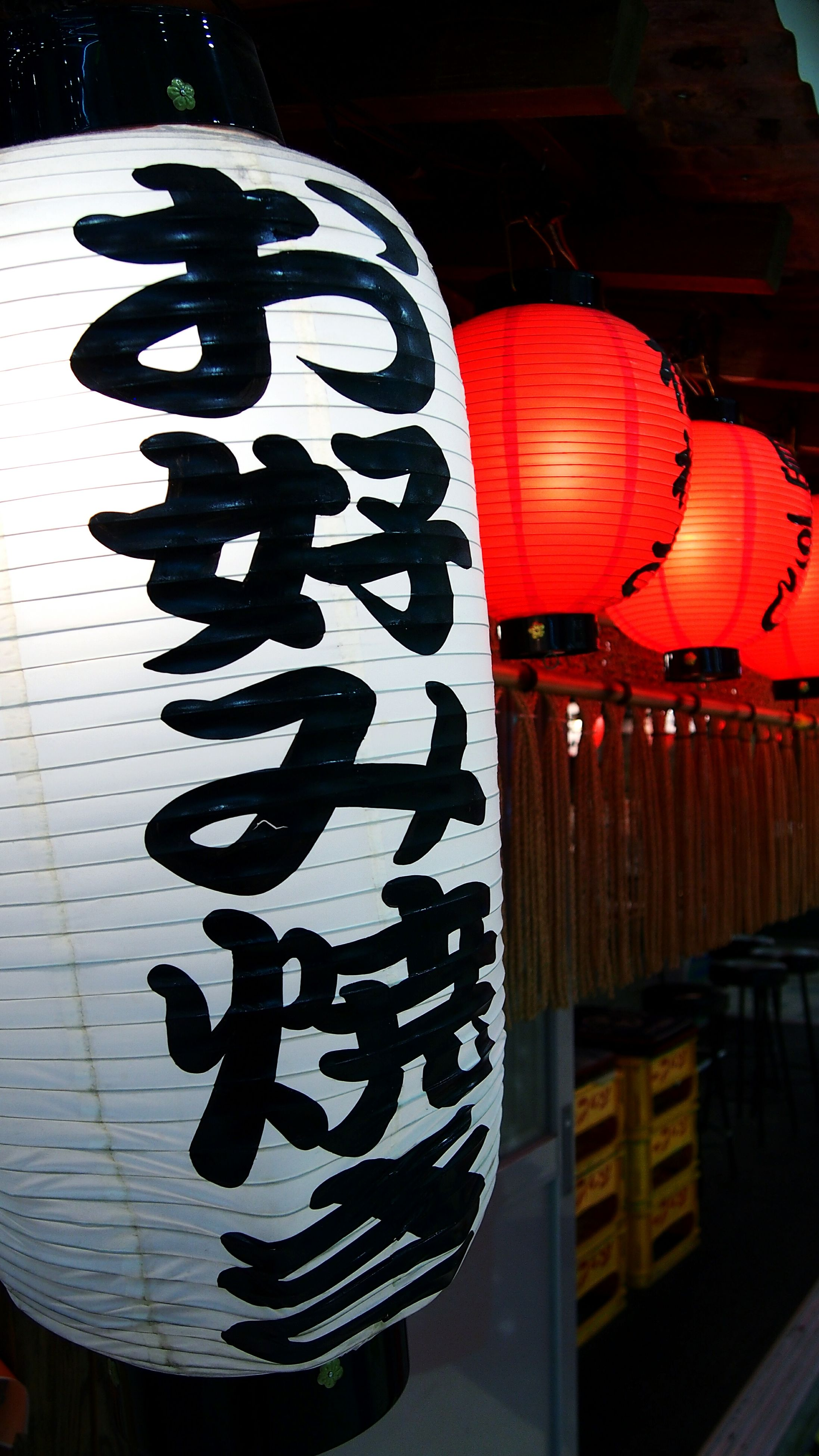 art and craft, pattern, illuminated, art, no people, indoors, creativity, design, absence, in a row, tradition, decoration, night, built structure, hanging, red, lantern, building exterior, empty
